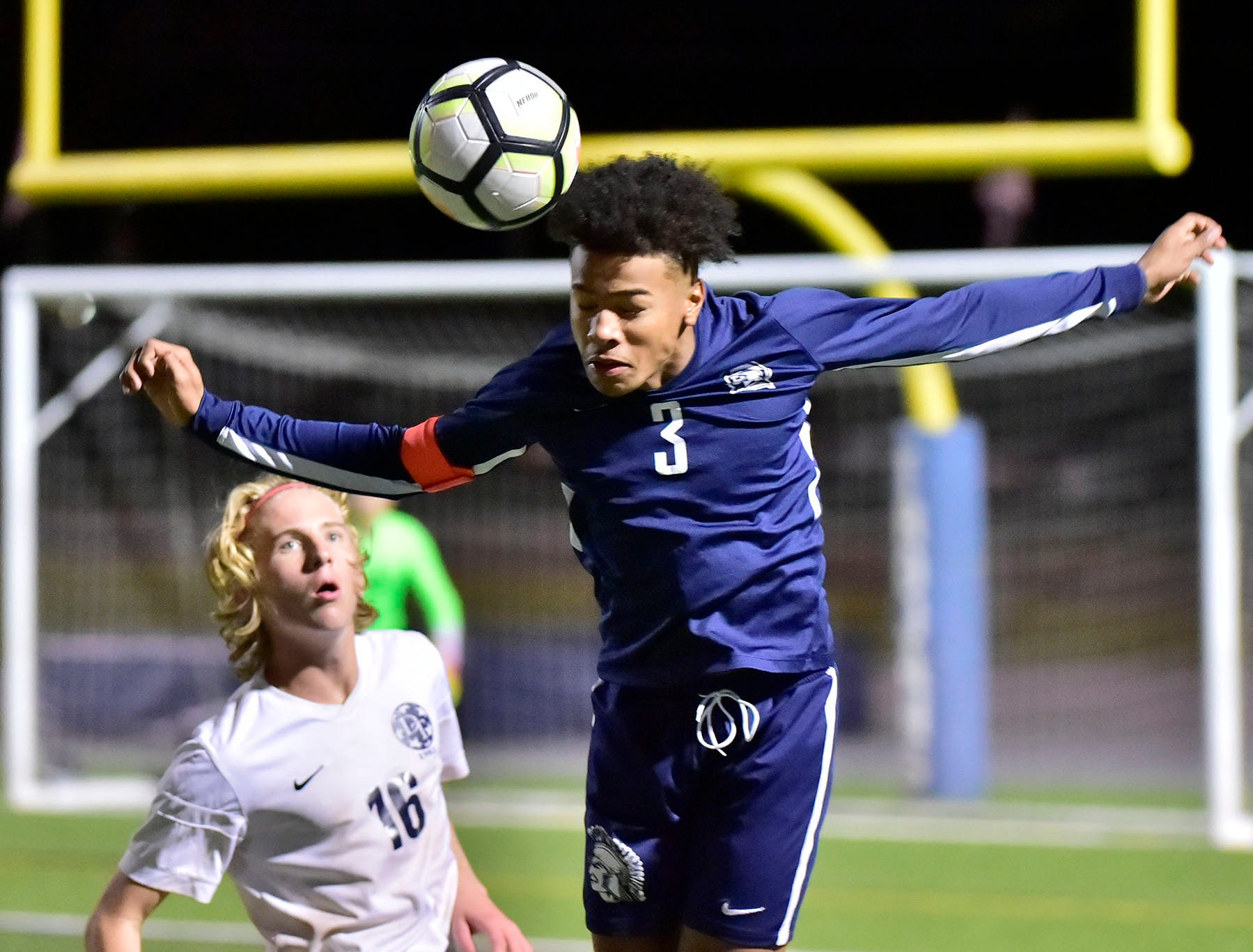 Ebe Hewitt of Chambersburg heads the ball in front of Cole Larson of Dallastown. Chambersburg lost a first round D3 soccer match to Dallastown 2-1 on Tuesday, Oct. 23, 2018.