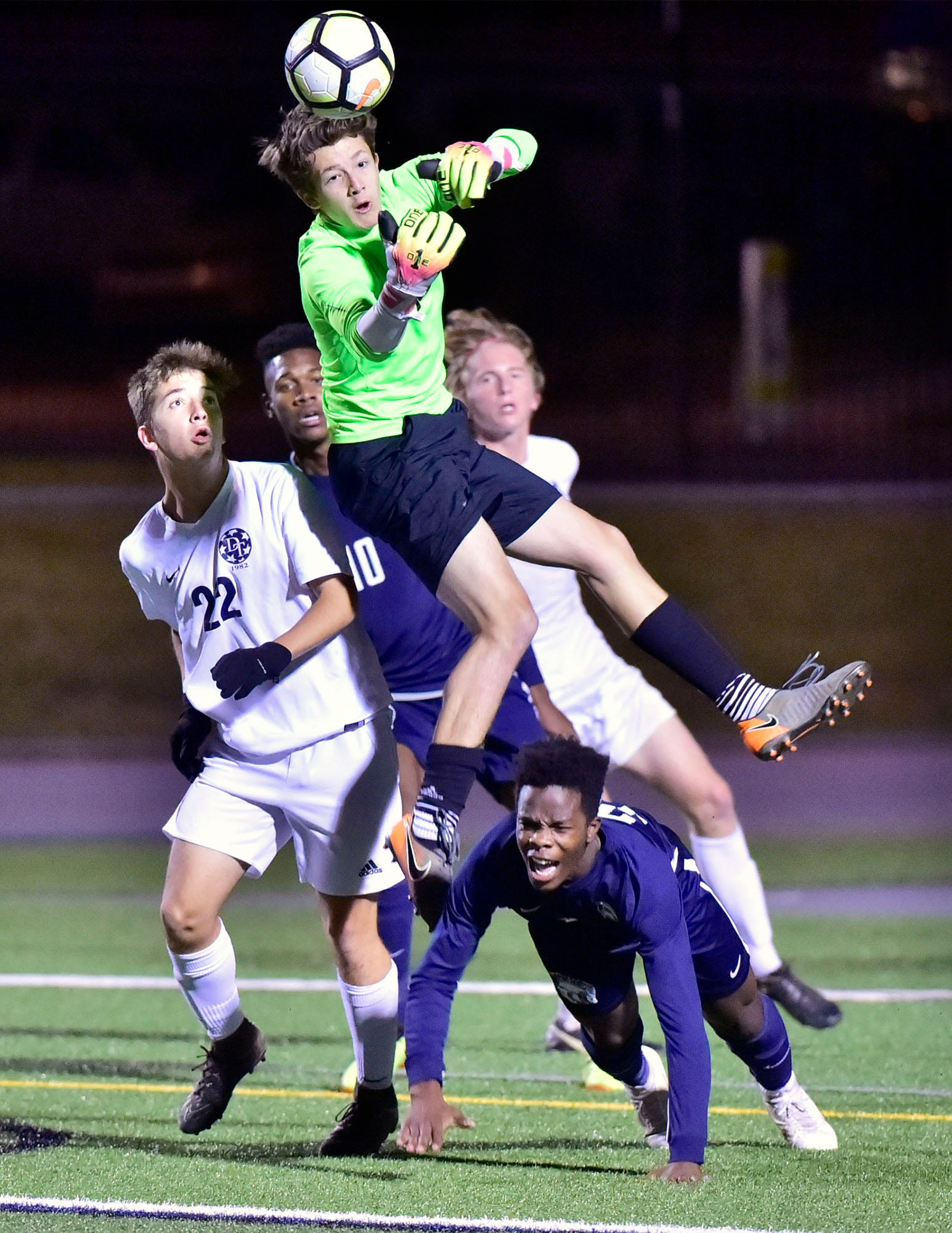 Keeper Gavin Conners, front, leaps to save the ball. Chambersburg lost a first round D3 soccer match to Dallastown 2-1 on Tuesday, Oct. 23, 2018.