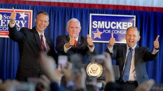 Vice President Mike Pence rallies with candidates Scott Perry, left, and Lloyd Smucker during Pence's stop at Lancaster Airport in Lititz Wednesday, Oct. 24, 2018. Bill Kalina photo