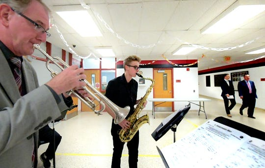 Dover High School music teacher George Bradshaw and junior Gabe Hurlbert play with the school's jazz quartet as people arrive at the State of the County address at the high school Tuesday, Oct. 23, 2018. Local groups showcased work before the presentation during which county commissioners and the York County Economic Alliance addressed the county's economic affairs. Bill Kalina photo