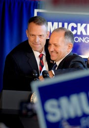 Republican incumbent candidates Scott Perry, left, and Lloyd Smucker greet each other during an appearance by Vice President Mike Pence who rallied at the Lancaster Airport in Lititz Wednesday, Oct. 24, 2018. Bill Kalina photo