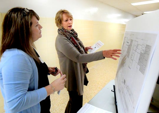 Kathy Seilhamer, Met-Ed government and community relations representative, talks with Laurel Oswalt, Dover Township manager, left, during the State of the County address at Dover High School Tuesday, Oct. 23, 2018. The two were discussing the Dover Township Public Works Feasibility Study. Local groups showcased work before the presentation during which county commissioners and the York County Economic Alliance addressed the county's economic affairs. Bill Kalina photo