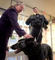 Patty McCandless of the York County Agricultural Land Preservation Board, visits with York County Sheriff Lt. David Godfrey and K-9 Dargo during the State of the County address at Dover High School Tuesday, Oct. 23, 2018. Local groups showcased work before the presentation during which county commissioners and the York County Economic Alliance addressed the county's economic affairs. Bill Kalina photo