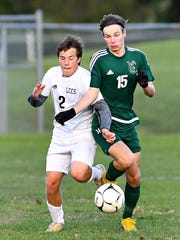 Jon Yinger, right, seen here in a file photo, scored two goals for York Catholic on Tuesday in a 3-0 win over Forest City.