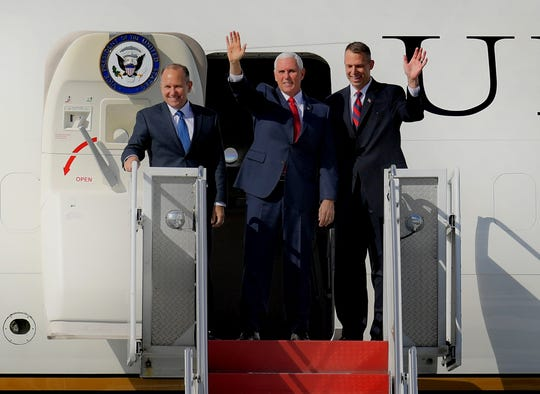 Vice President Mike Pence, center, emerges from Air Force Two with incumbent Republican candidates Lloyd Smucker, left, and Scott Perry during Pence's stop at Lancaster Airport in Lititz Wednesday, Oct. 24, 2018. Bill Kalina photo