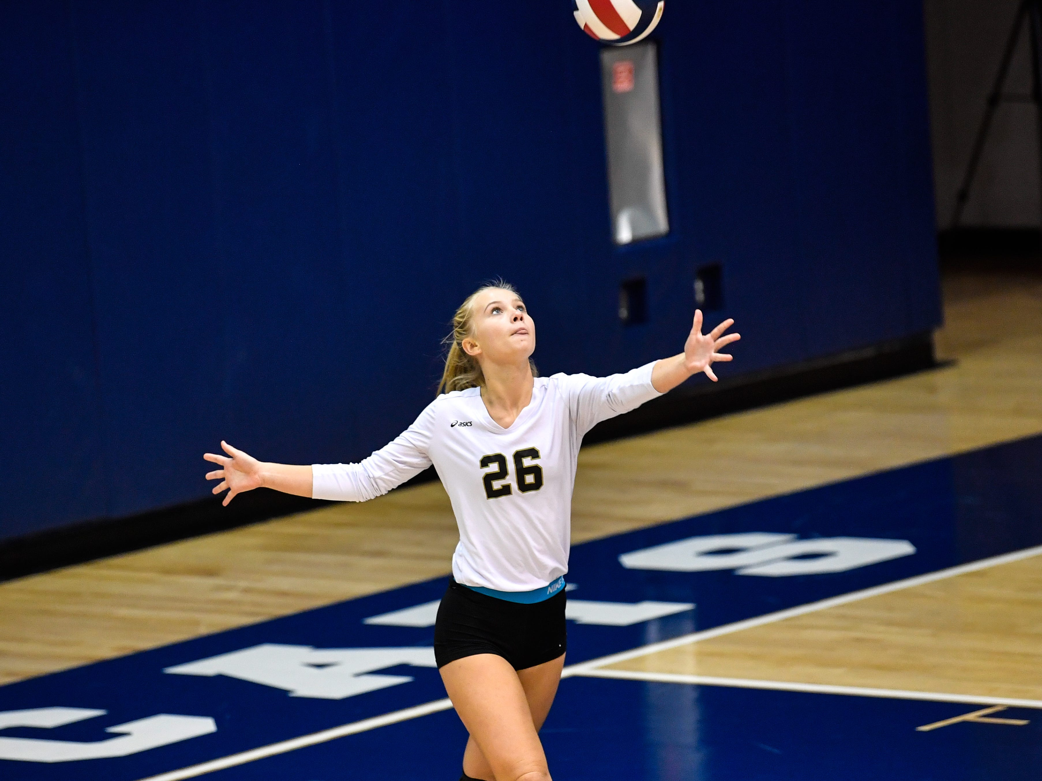 Abby Smith (26) begins her serve during the YAIAA league volleyball tournament semifinals between Eastern York and Delone Catholic, Tuesday, October 23, 2018. The Squirettes defeated the Golden Knights 3-2.