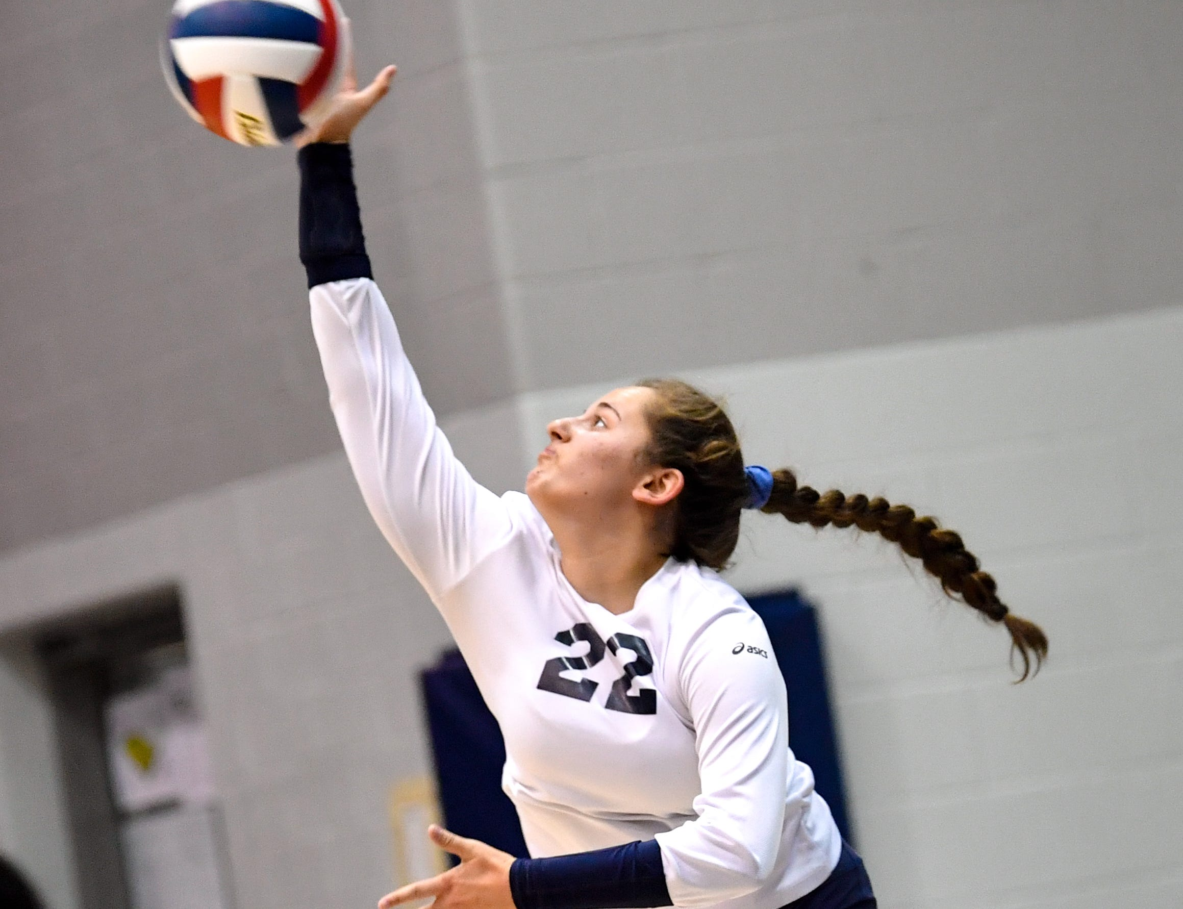 Kelsey Hasson (22) sends the ball over the net during the YAIAA league volleyball tournament semifinals between West York and Dover, Tuesday, October 23, 2018. The Bulldogs defeated the Eagles 3-1.