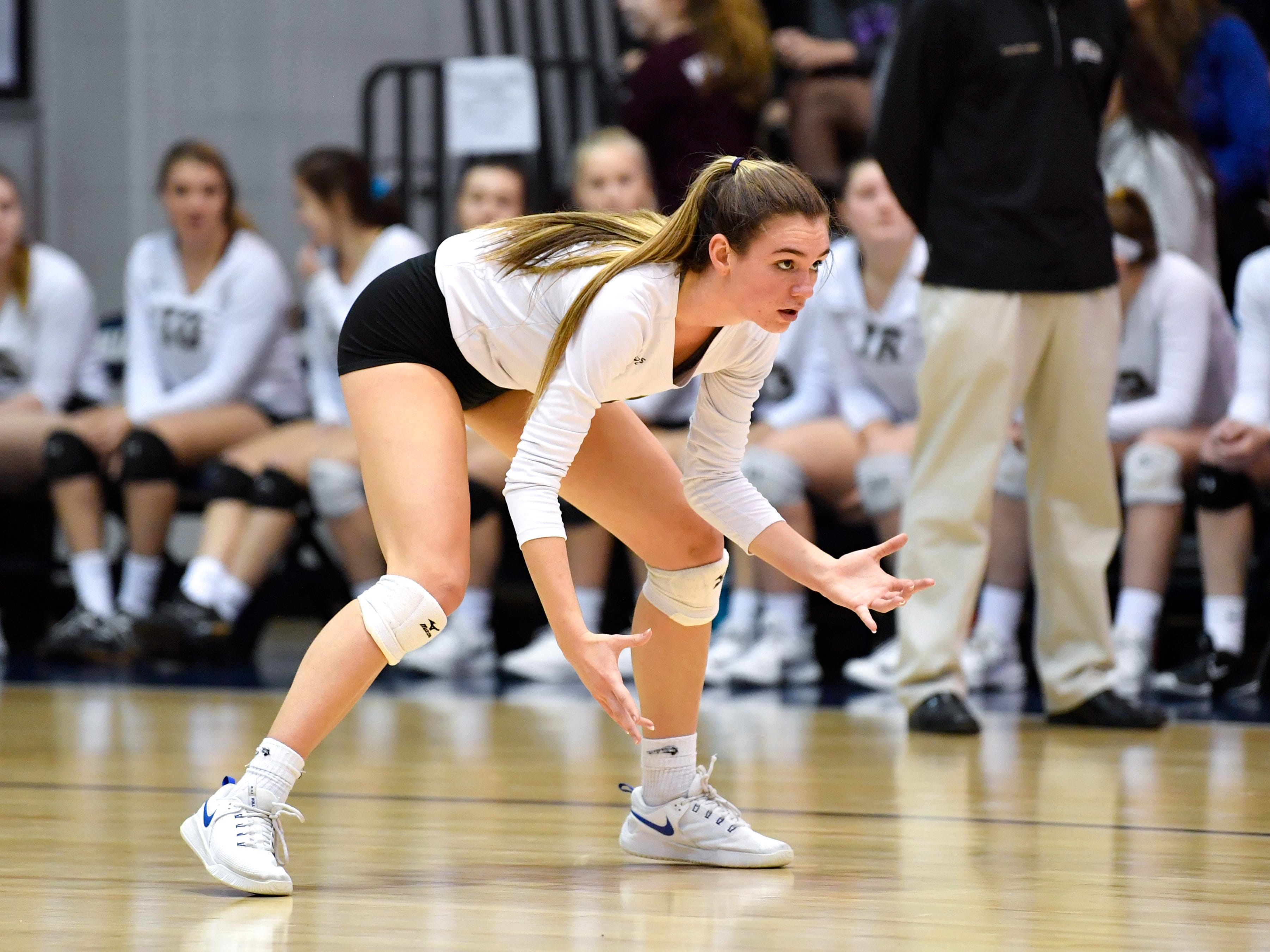 Maddie Clabaugh (1) of Delone Catholic gets low as Eastern York serves during the YAIAA league volleyball tournament semifinals between Eastern York and Delone Catholic, Tuesday, October 23, 2018. The Squirettes defeated the Golden Knights 3-2.