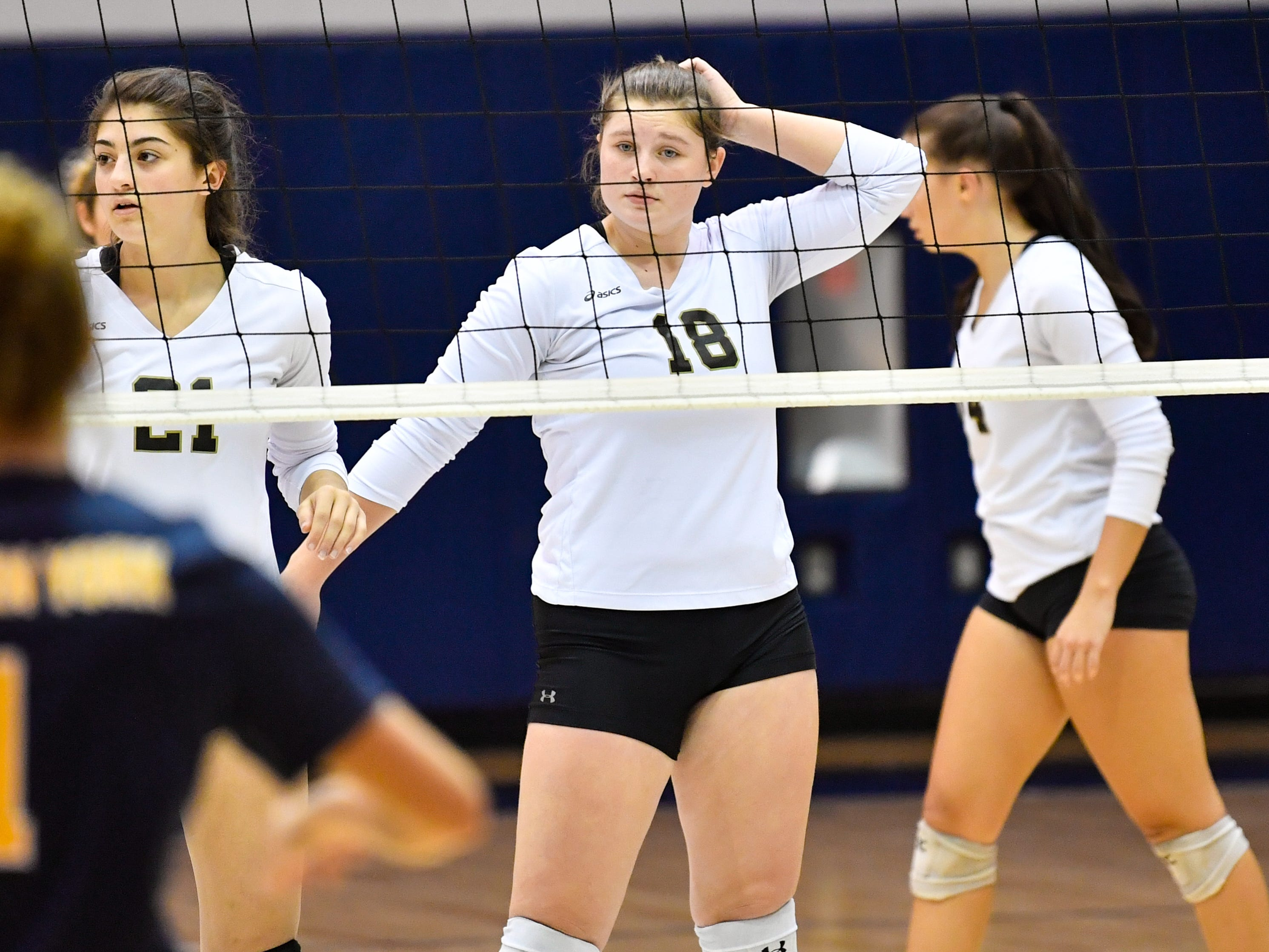 Maggie Sieg (18) of Delone Catholic watches the serve during the YAIAA league volleyball tournament semifinals between Eastern York and Delone Catholic, Tuesday, October 23, 2018. The Squirettes defeated the Golden Knights 3-2.