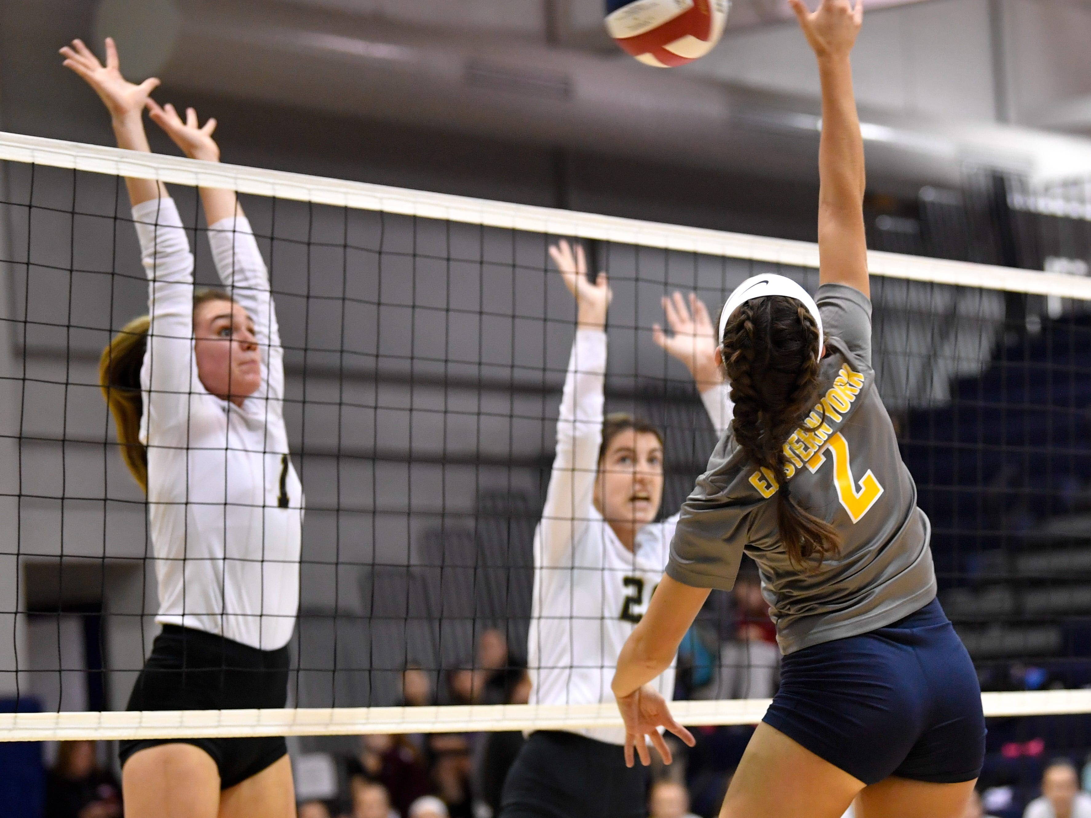 Morgan Dobbeck (2) attempts to spike the ball past Delone Catholic during the YAIAA league volleyball tournament semifinals between Eastern York and Delone Catholic, Tuesday, October 23, 2018. The Squirettes defeated the Golden Knights 3-2.