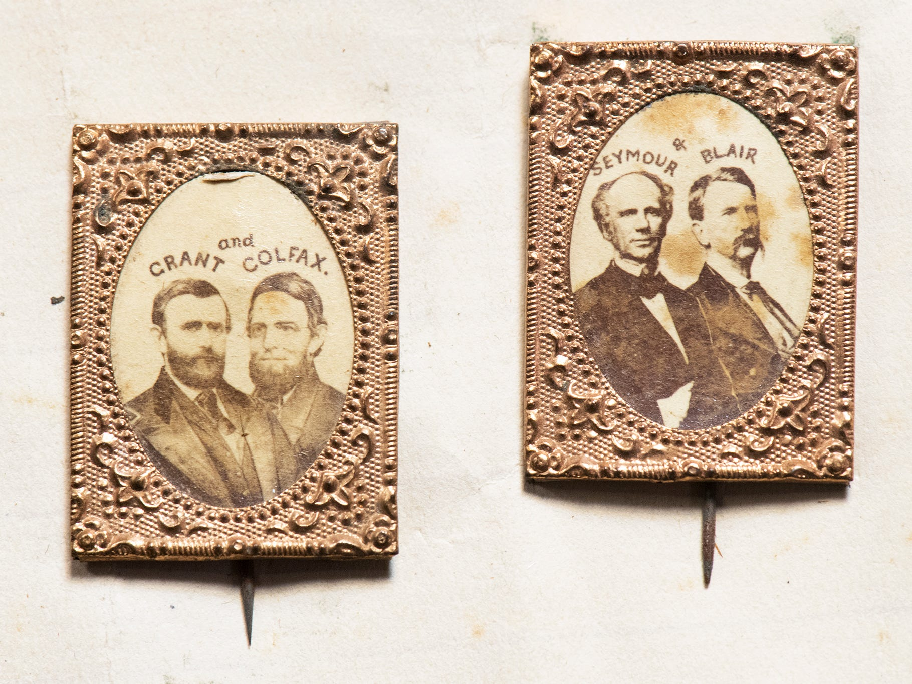 These are political pins for the 1868 U.S. presidential election. Albumin jugate photographs with views of Ulysses S. Grant and Schuyler Colfax, left, and Horatio Seymour and Francis Preston Blair Jr., right, are to be auctioned off during the Blair Family, Fine Arts & Antiques Auction at Keystone Auctions LLC Saturday, October 27, 2018 at 9 a.m.
