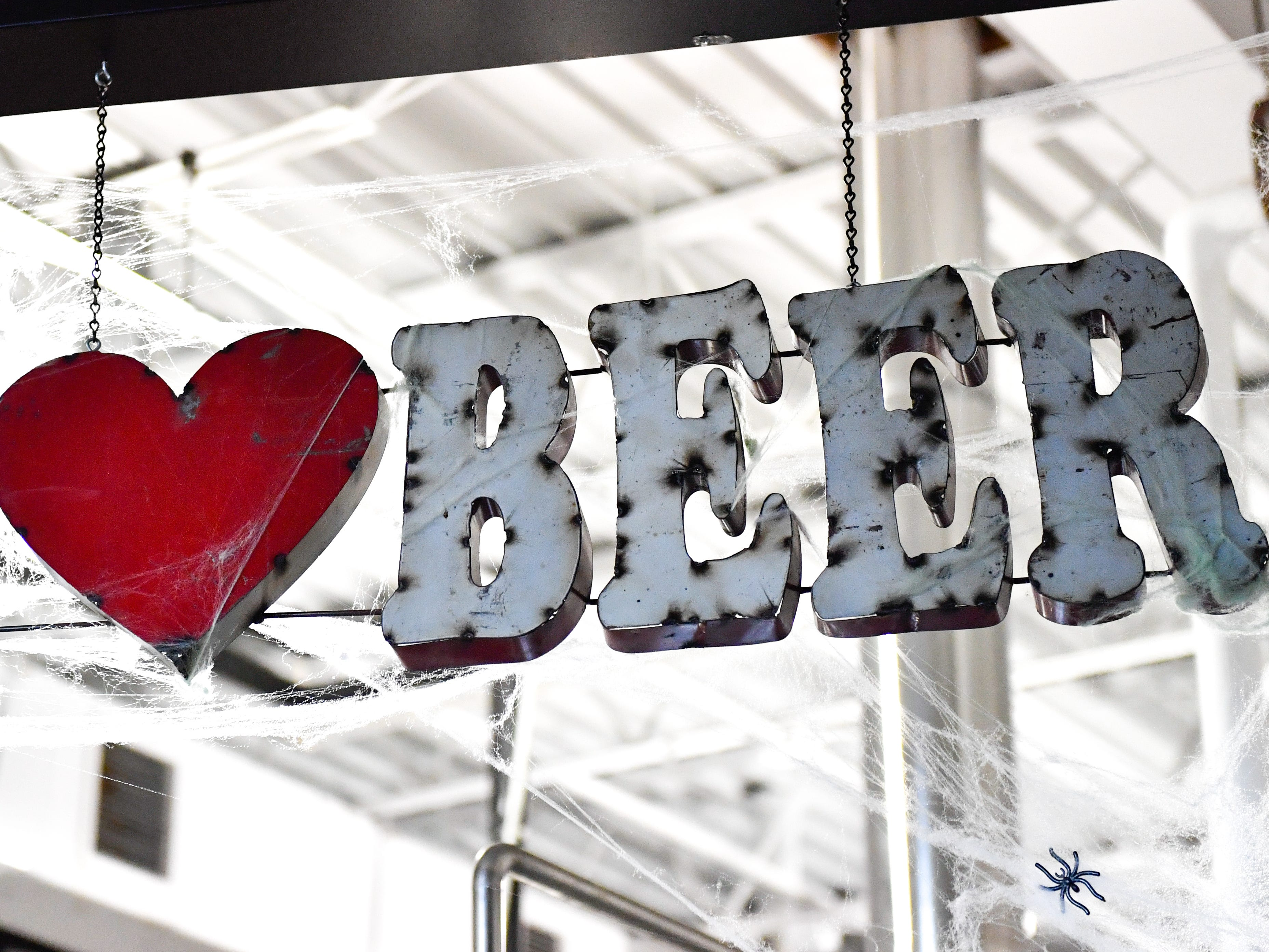 This sign sits above the brewery at the Mexitaly Brick oven Brewhouse, October 19, 2018.