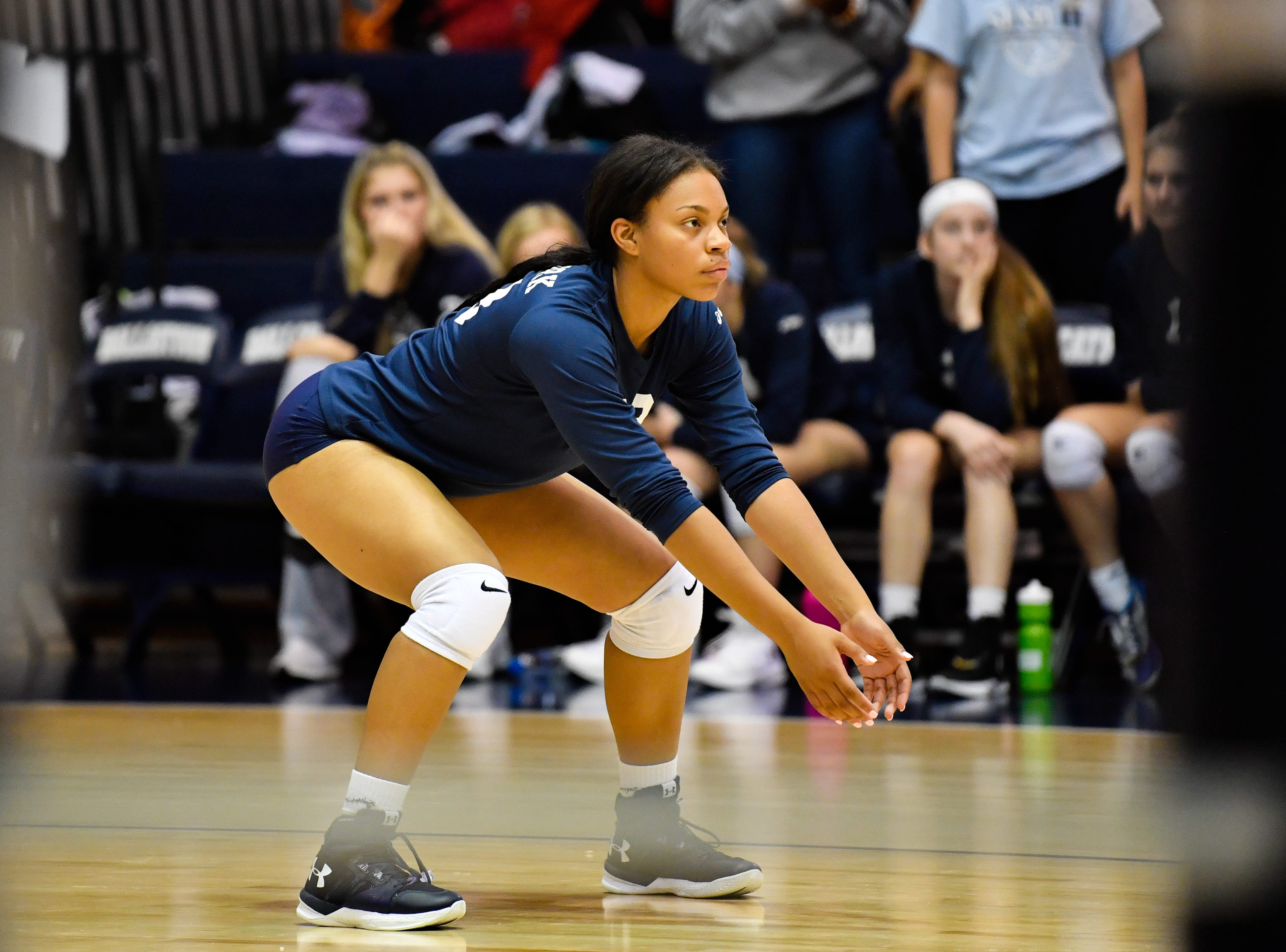 Alayna Harris (23) gets into her stance during the YAIAA league volleyball tournament semifinals between West York and Dover, Tuesday, October 23, 2018. The Bulldogs defeated the Eagles 3-1.