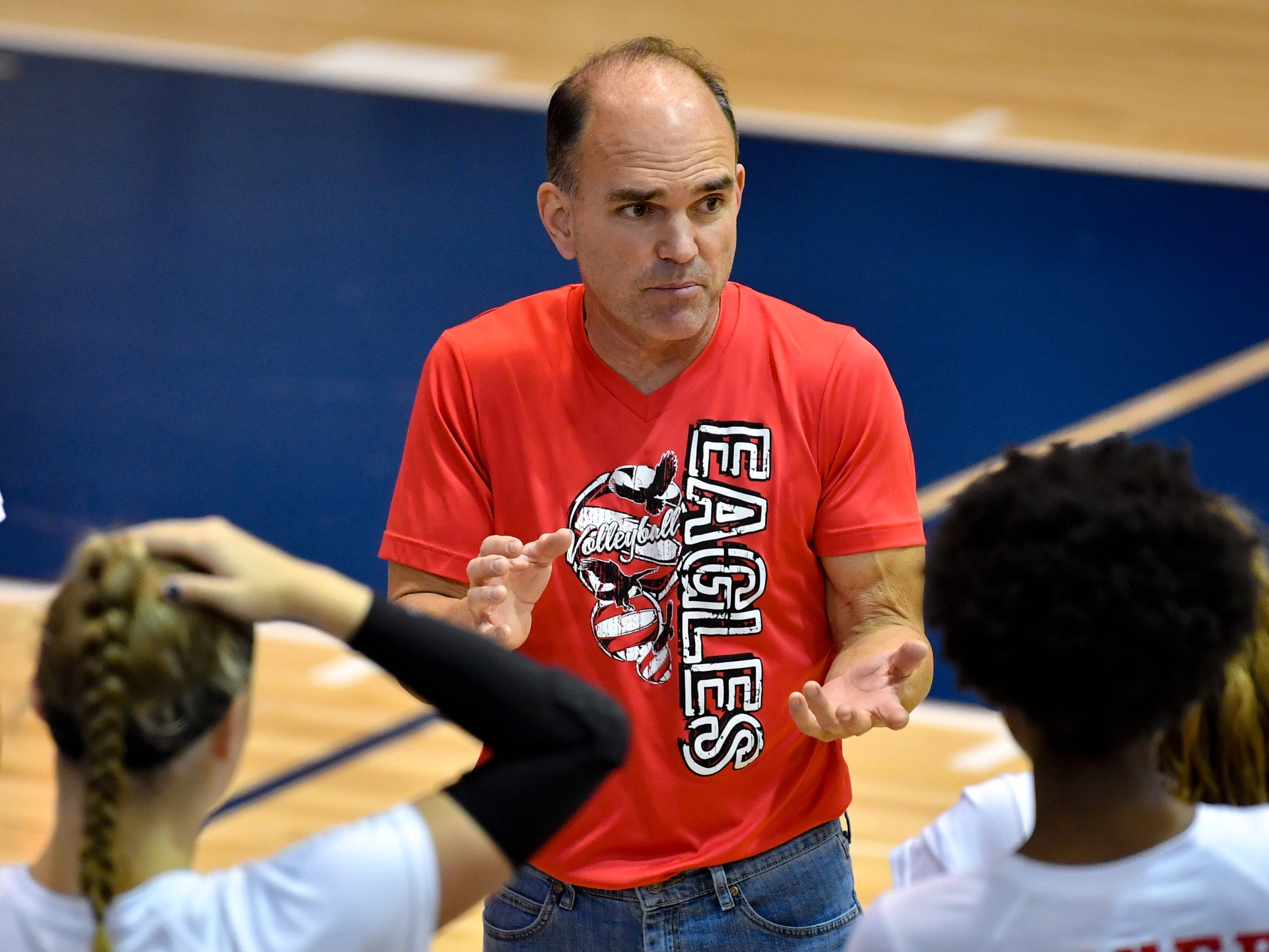 Dover head coach Brett Hoffman motivates his team during the YAIAA league volleyball tournament semifinals between West York and Dover, Tuesday, October 23, 2018. The Bulldogs defeated the Eagles 3-1.