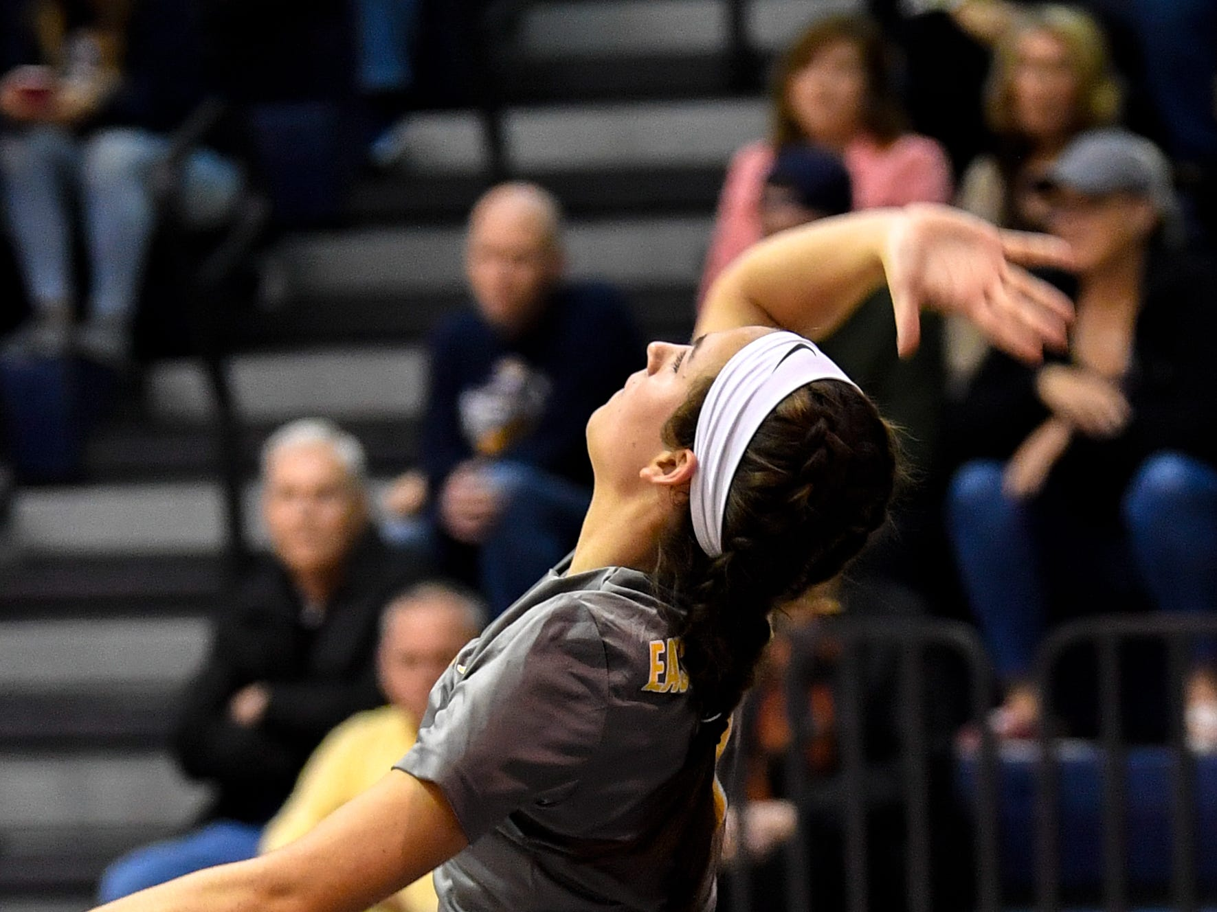 Morgan Dobbeck (2) prepares to send the ball over the net during the YAIAA league volleyball tournament semifinals between Eastern York and Delone Catholic, Tuesday, October 23, 2018. The Squirettes defeated the Golden Knights 3-2.