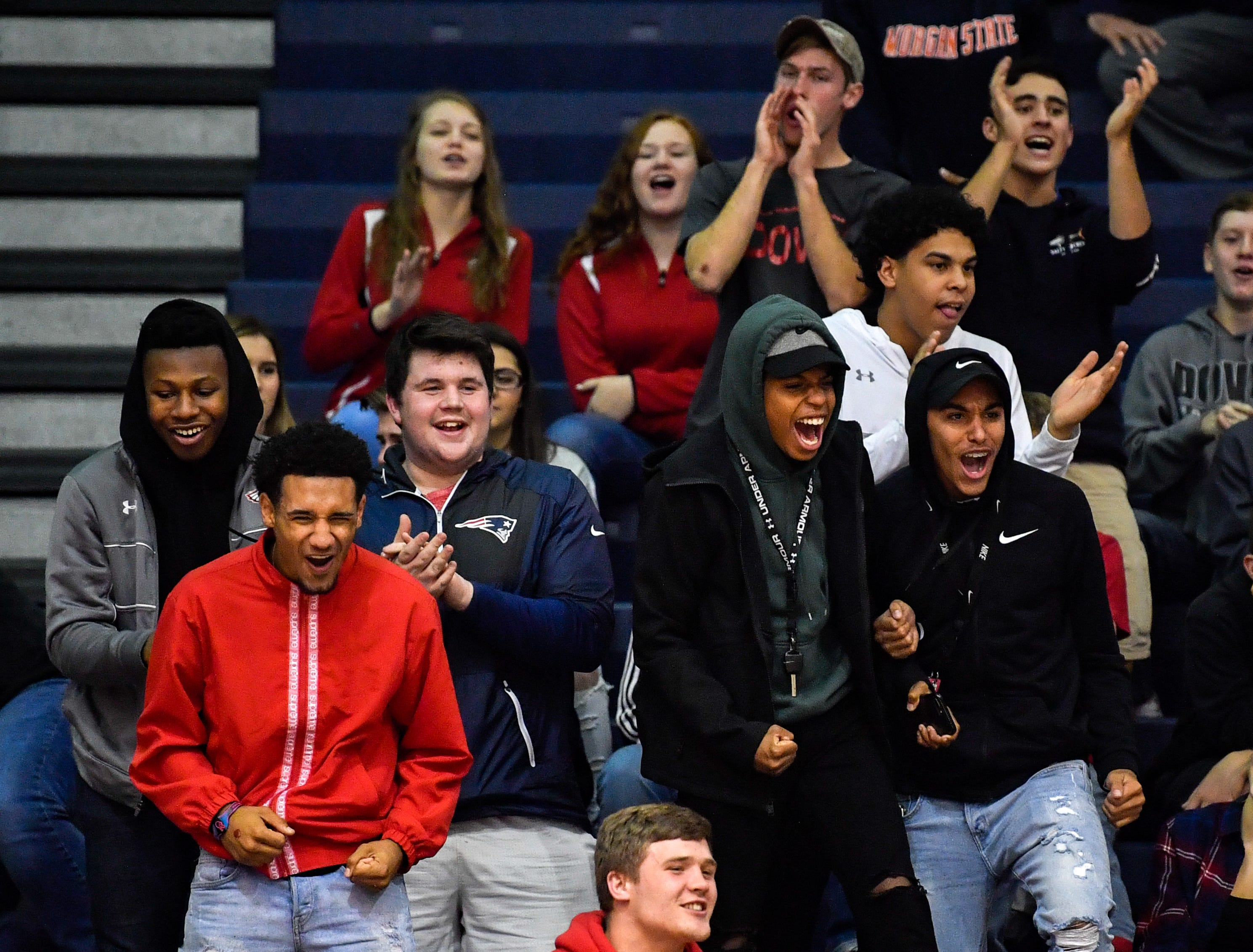 Dover has their own cheering section during the YAIAA league volleyball tournament semifinals between West York and Dover, Tuesday, October 23, 2018. The Bulldogs defeated the Eagles 3-1.