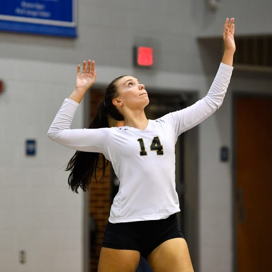 Molly Raville (14) serves the ball during the YAIAA league volleyball tournament semifinals between Eastern York and Delone Catholic, Tuesday, October 23, 2018. The Squirettes defeated the Golden Knights 3-2.