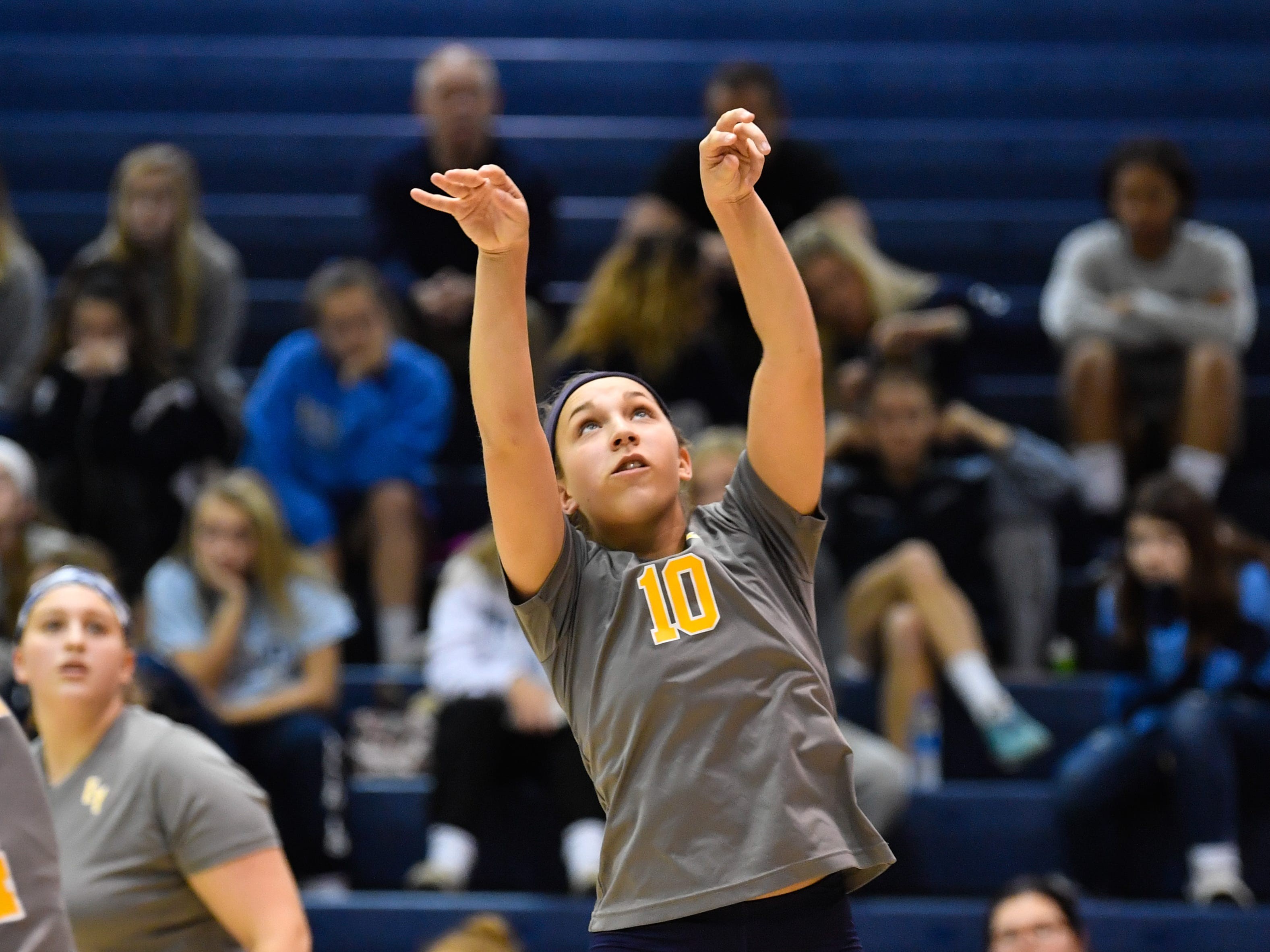 Katie Lehman (10) sets the ball during the YAIAA league volleyball tournament semifinals between Eastern York and Delone Catholic, Tuesday, October 23, 2018. The Squirettes defeated the Golden Knights 3-2.