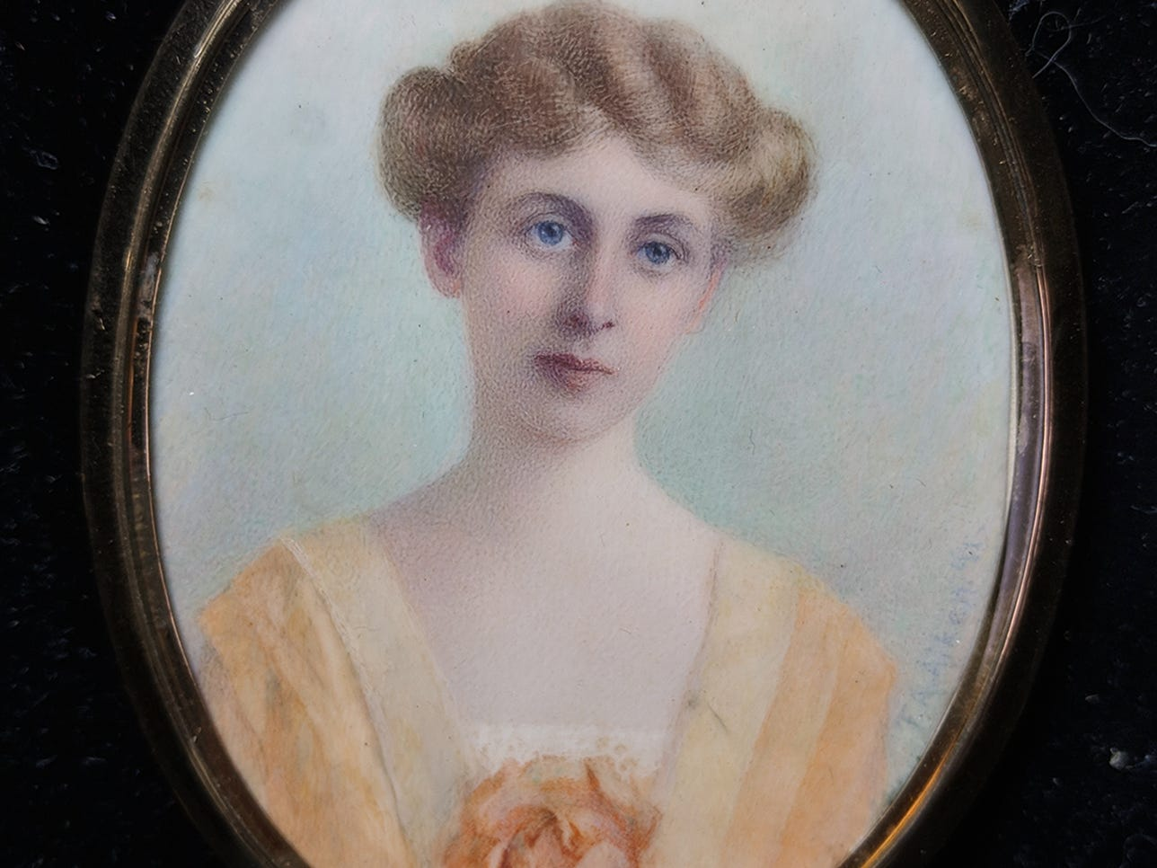 A portrait of Emily Hockaday Blair in 14K gold frame is to be auctioned. Her name is engraved on the back.