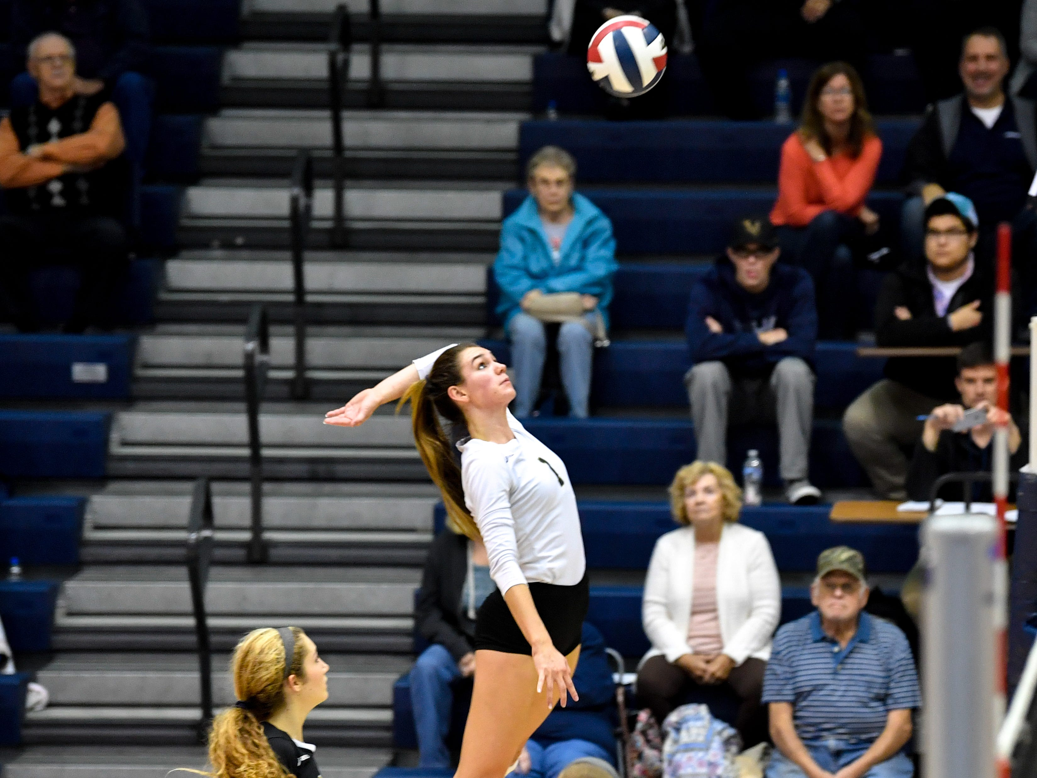 Maddie Clabaugh (1) of Delone Catholic rises up for a spike during the YAIAA league volleyball tournament semifinals between Eastern York and Delone Catholic, Tuesday, October 23, 2018. The Squirettes defeated the Golden Knights 3-2.