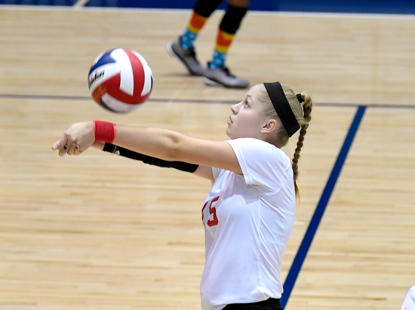 Dover's Abby Diehl (15) bumps the ball during the YAIAA league volleyball tournament semifinals between West York and Dover, Tuesday, October 23, 2018. The Bulldogs defeated the Eagles 3-1.