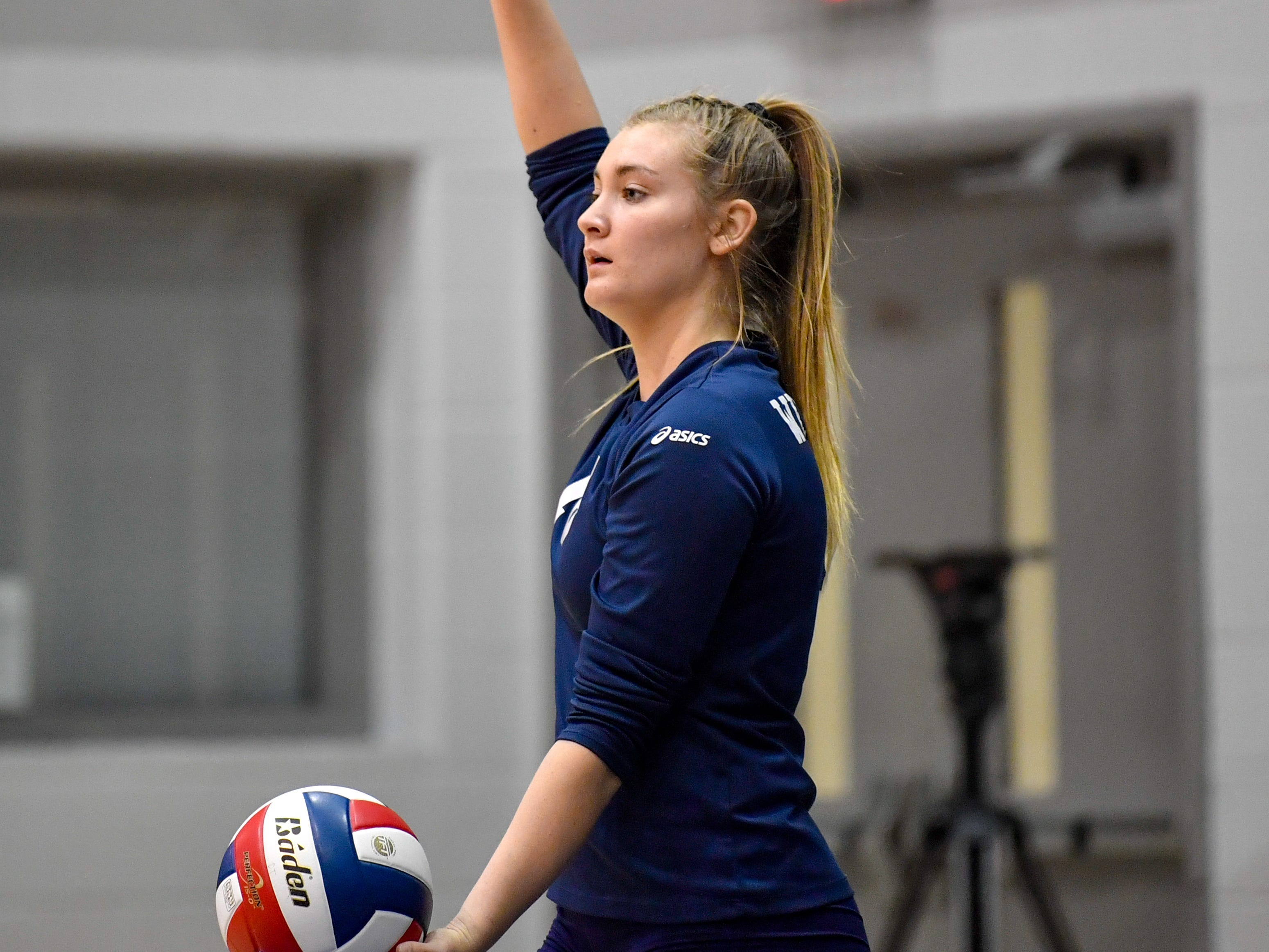 Georgianna Kahley (16) of West York decides where to serve the ball during the YAIAA league volleyball tournament semifinals between West York and Dover, Tuesday, October 23, 2018. The Bulldogs defeated the Eagles 3-1.