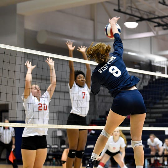 Julia Rill spikes the ball hard during the YAIAA league volleyball tournament semifinals between West York and Dover, Tuesday, October 23, 2018. The Bulldogs defeated the Eagles 3-1.
