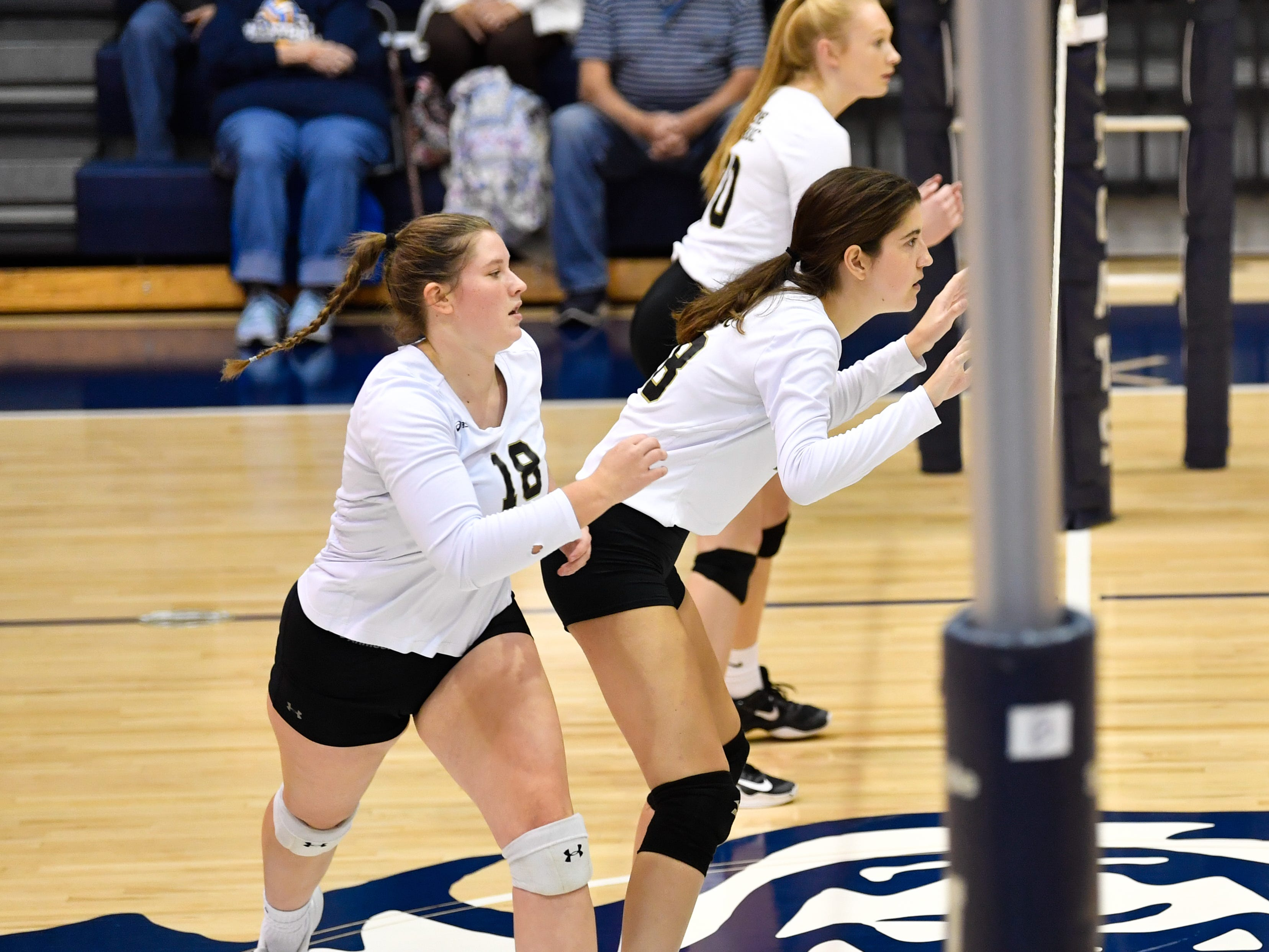 Delone Catholic is prepares to block a spike during the YAIAA league volleyball tournament semifinals between Eastern York and Delone Catholic, Tuesday, October 23, 2018. The Squirettes defeated the Golden Knights 3-2.
