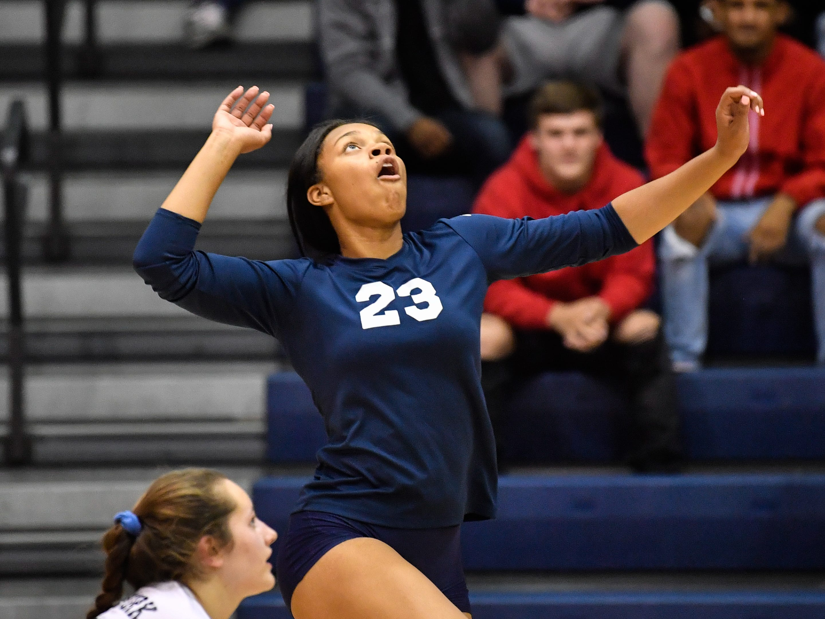 Alayna Harris (23) rises up for the spike during the YAIAA league volleyball tournament semifinals between West York and Dover, Tuesday, October 23, 2018. The Bulldogs defeated the Eagles 3-1.