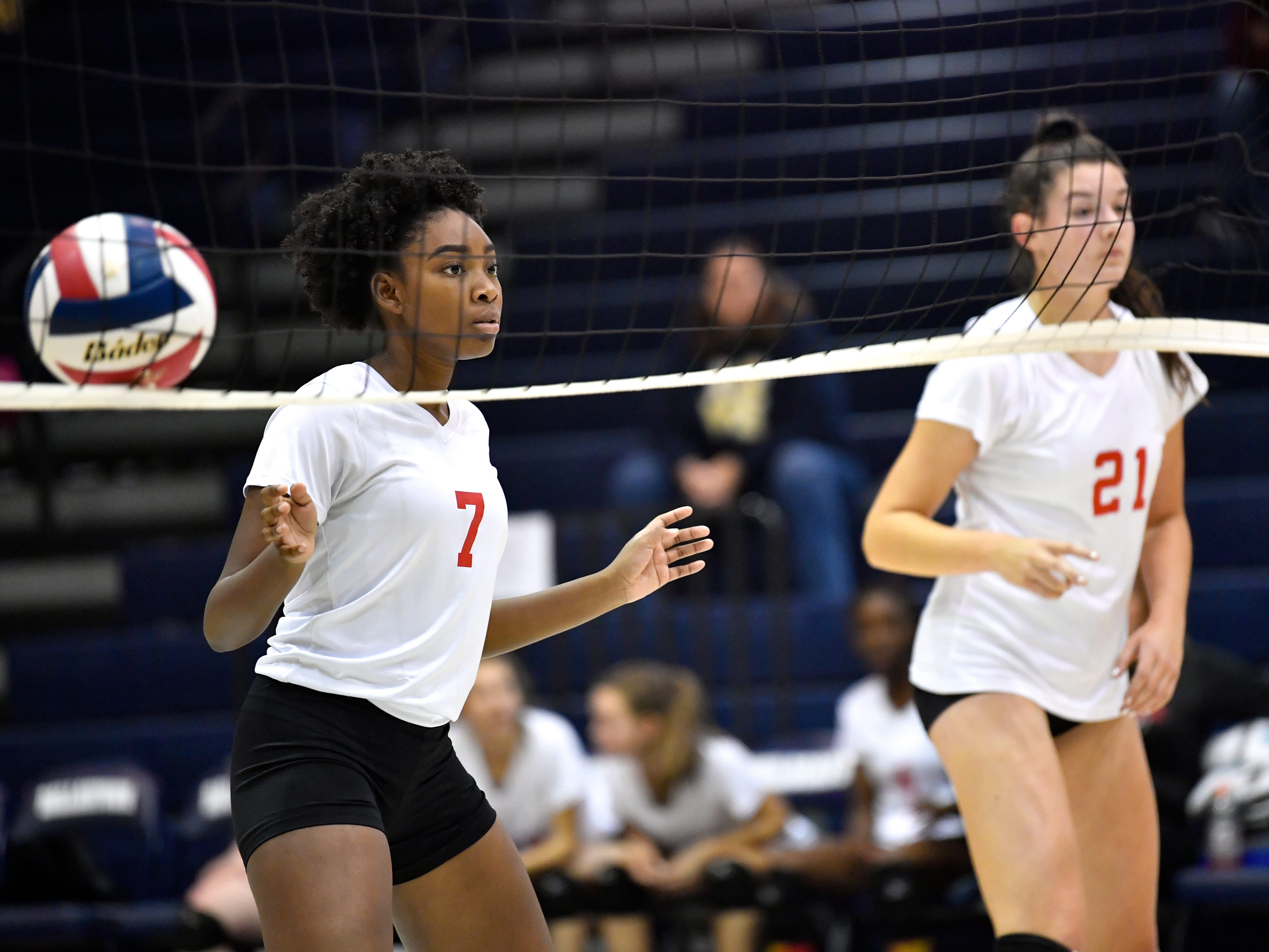 Triana Krider (7) and Emma Davis (21) stand at the net during the YAIAA league volleyball tournament semifinals between West York and Dover, Tuesday, October 23, 2018. The Bulldogs defeated the Eagles 3-1.