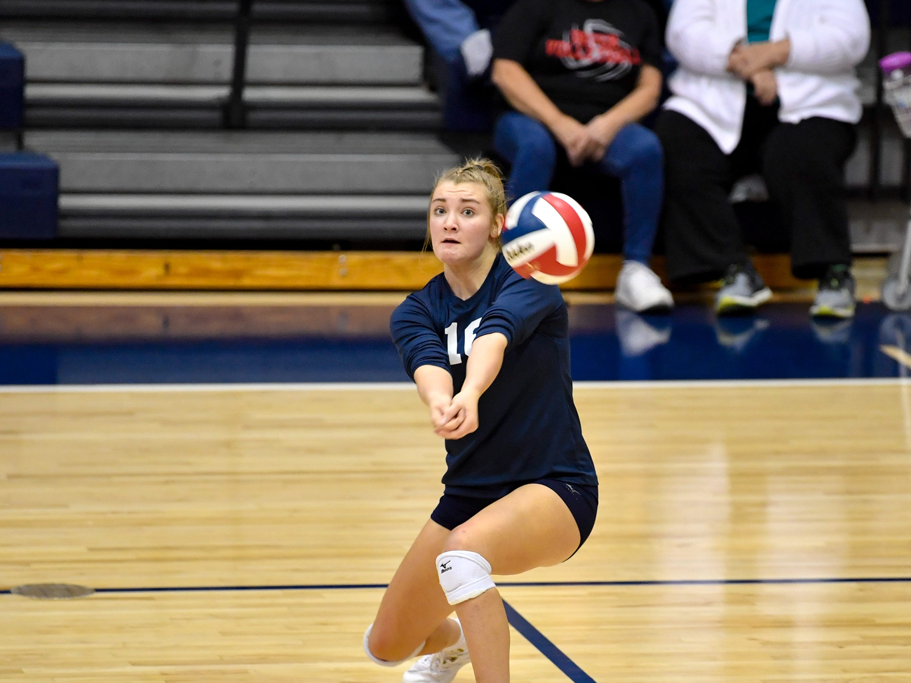 Georgianna Kahley (16) narrowly misses the ball during the YAIAA league volleyball tournament semifinals between West York and Dover, Tuesday, October 23, 2018. The Bulldogs defeated the Eagles 3-1.