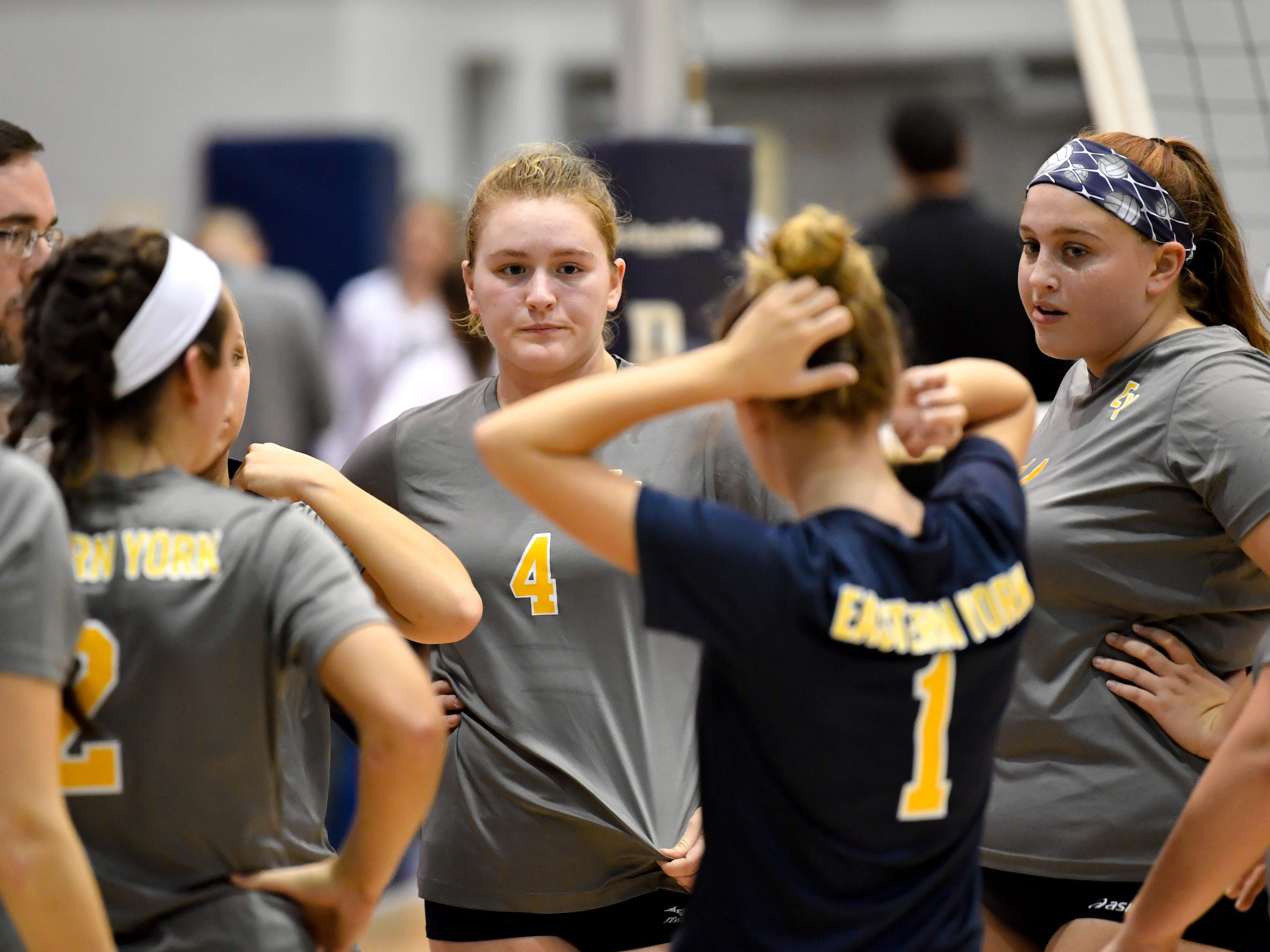 Eastern York talks strategy during a timeout during the YAIAA league volleyball tournament semifinals between Eastern York and Delone Catholic, Tuesday, October 23, 2018. The Squirettes defeated the Golden Knights 3-2.