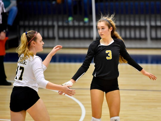 Lauren Trummer (3) congratulates a teammate after they score during the YAIAA league volleyball tournament semifinals between Eastern York and Delone Catholic, Tuesday, October 23, 2018. The Squirettes defeated the Golden Knights 3-2.