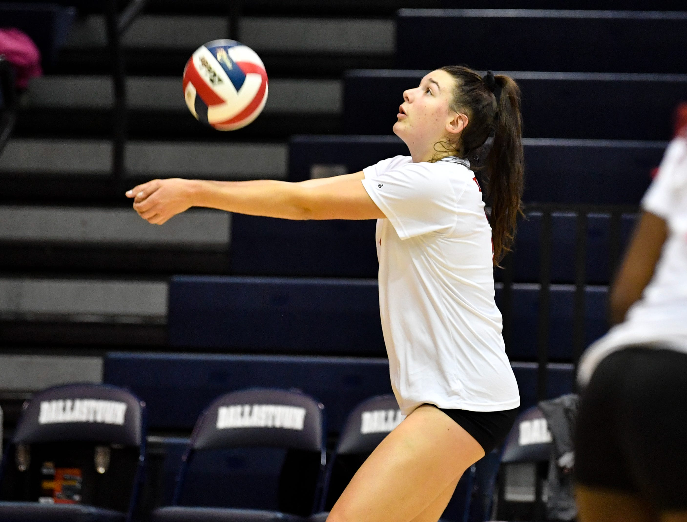 Emma Davis (21) keeps the ball in play during the YAIAA league volleyball tournament semifinals between West York and Dover, Tuesday, October 23, 2018. The Bulldogs defeated the Eagles 3-1.
