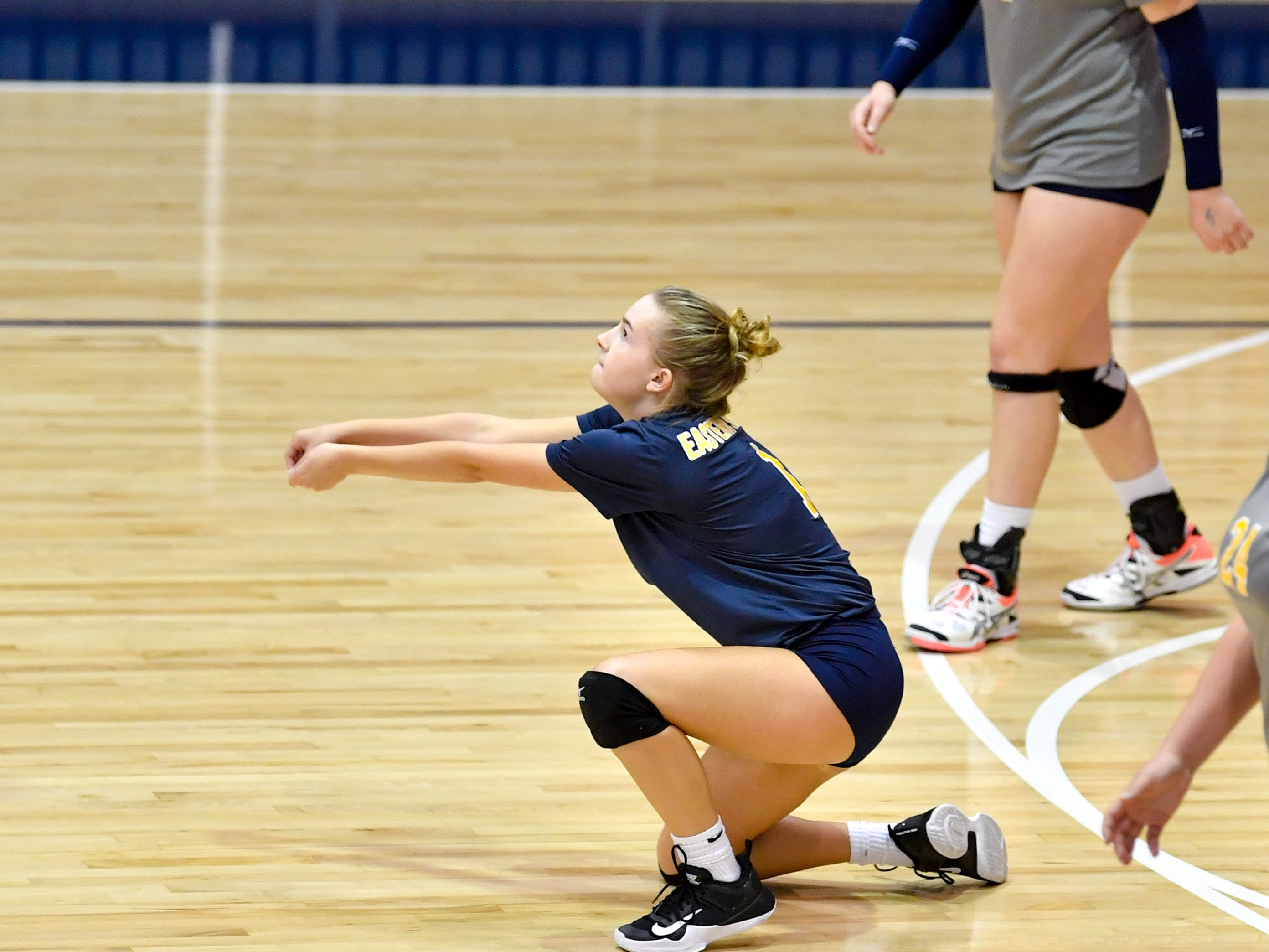 Olivia Koicuba (1) bumps the ball during the YAIAA league volleyball tournament semifinals between Eastern York and Delone Catholic, Tuesday, October 23, 2018. The Squirettes defeated the Golden Knights 3-2.