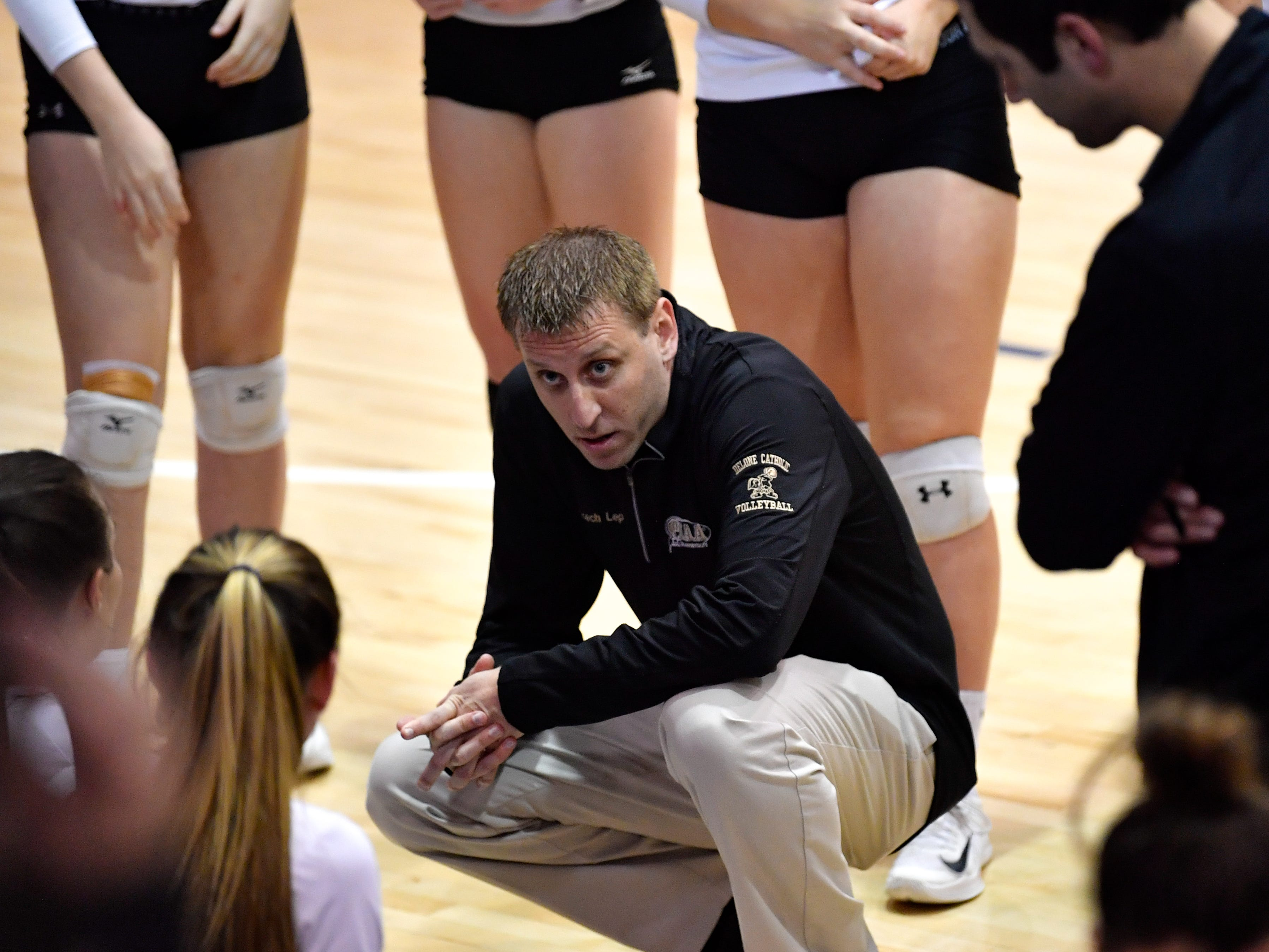 Delone Catholic head coach Jason Leppo motivates his players during the YAIAA league volleyball tournament semifinals between Eastern York and Delone Catholic, Tuesday, October 23, 2018. The Squirettes defeated the Golden Knights 3-2.