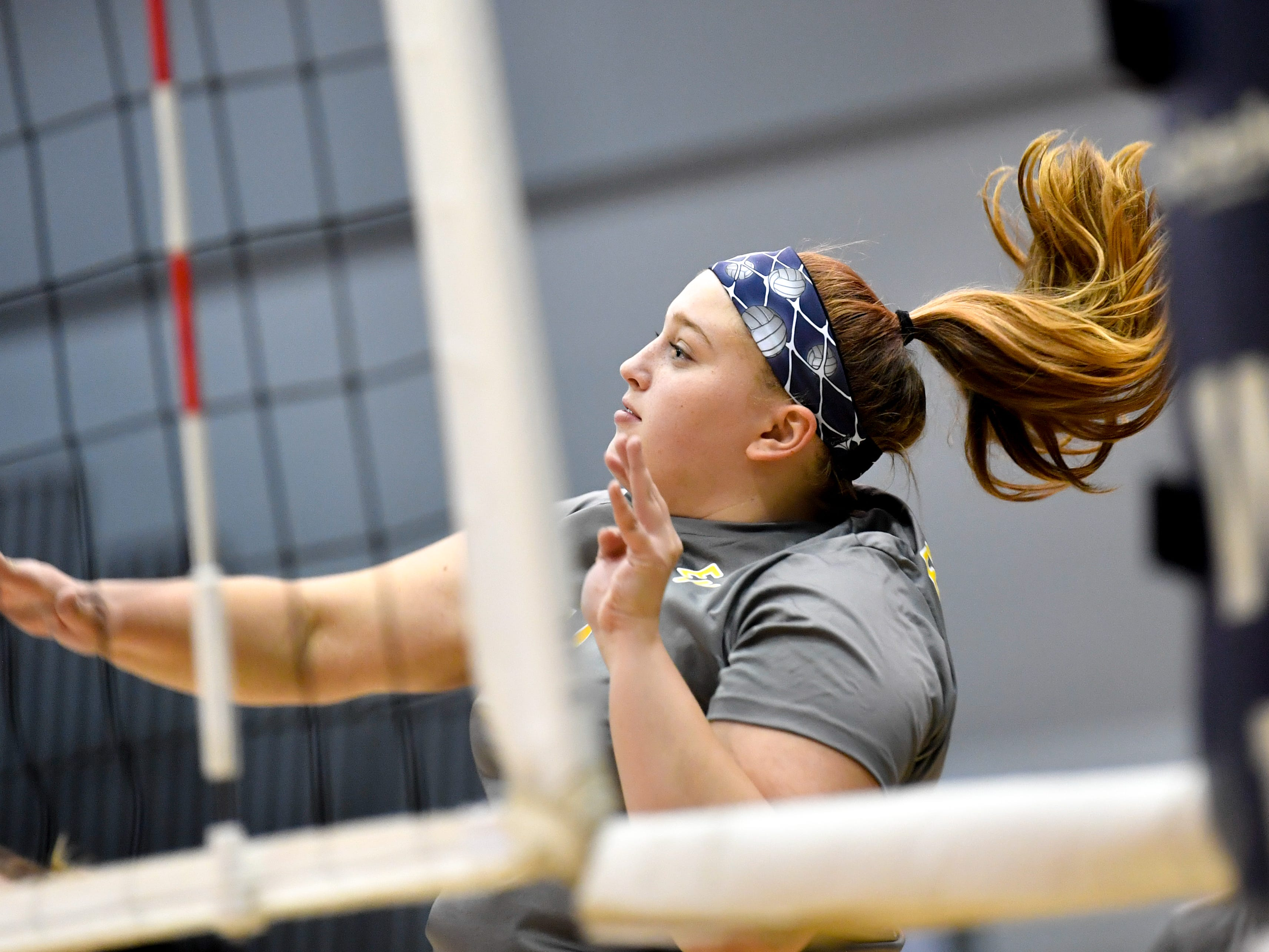 Elise Sprenkle (14) sends the ball back over the net during the YAIAA league volleyball tournament semifinals between Eastern York and Delone Catholic, Tuesday, October 23, 2018. The Squirettes defeated the Golden Knights 3-2.