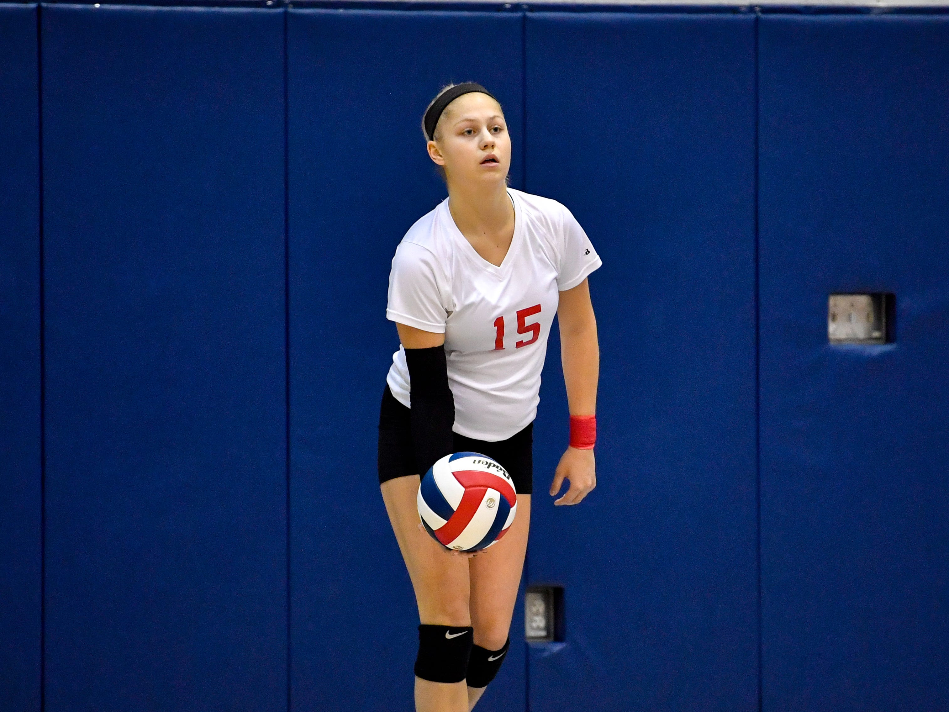 Abby Diehl (15) of Dover gets ready to serve during the YAIAA league volleyball tournament semifinals between West York and Dover, Tuesday, October 23, 2018. The Bulldogs defeated the Eagles 3-1.