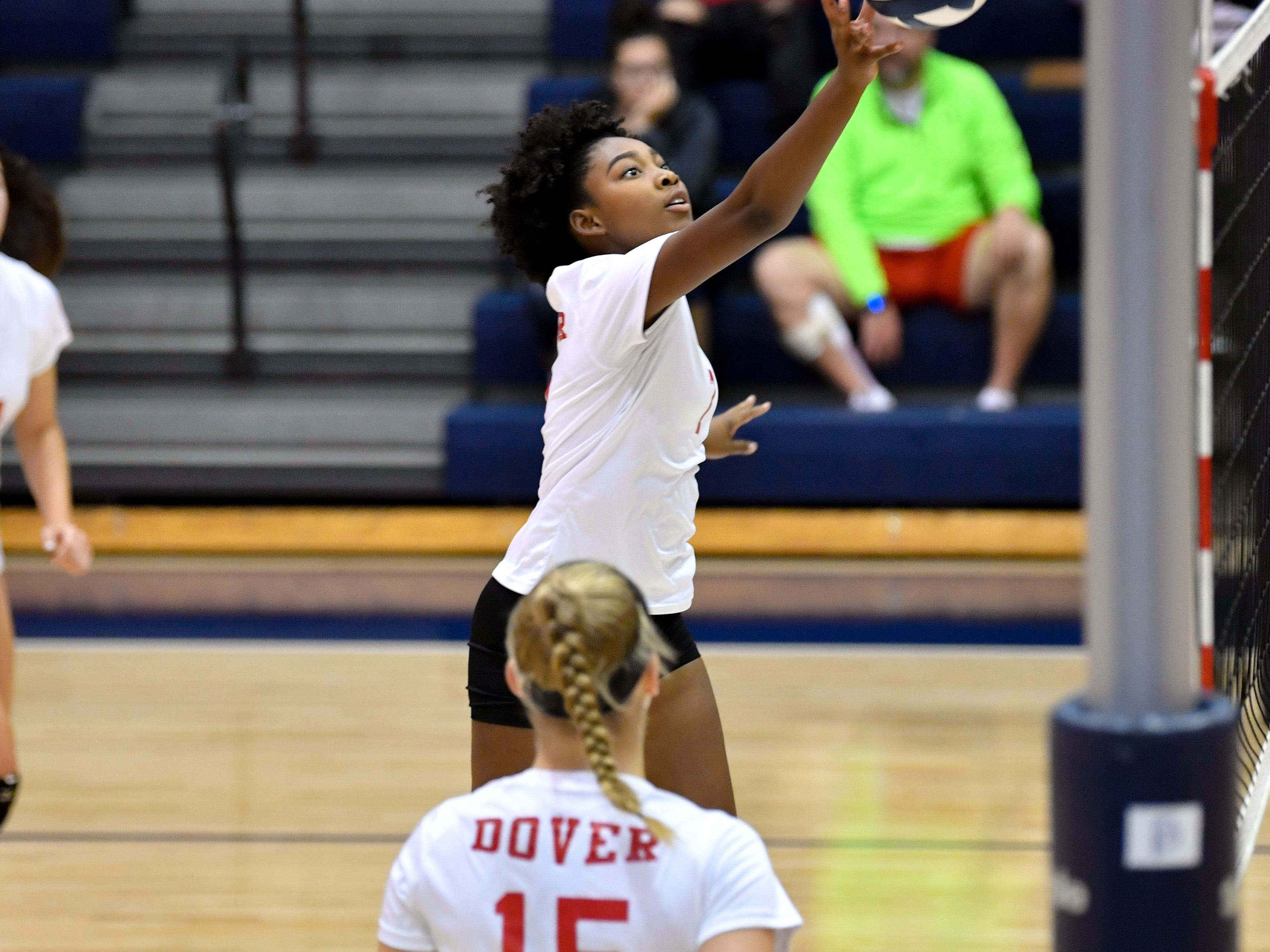 Triana Krider (7) taps the ball over the net during the YAIAA league volleyball tournament semifinals between West York and Dover, Tuesday, October 23, 2018. The Bulldogs defeated the Eagles 3-1.