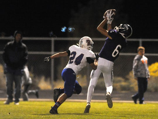 Spanish Springs' Trey Hummel (6) catches a touchdown pass over Reno's Anthony Hill during their football game at Spanish Springs on Oct. 19, 2018.
