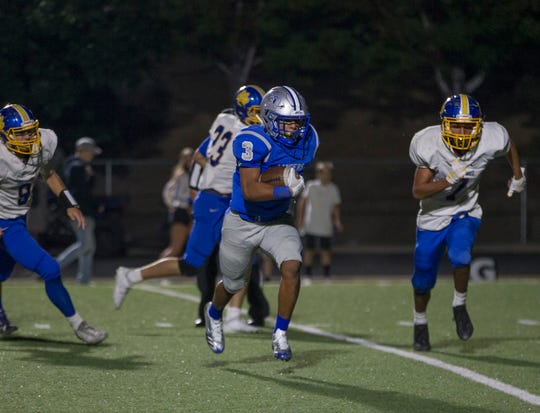 McQueen running back JD Kolb runs for touchdown  against Del Campo at McQueen on August 31.