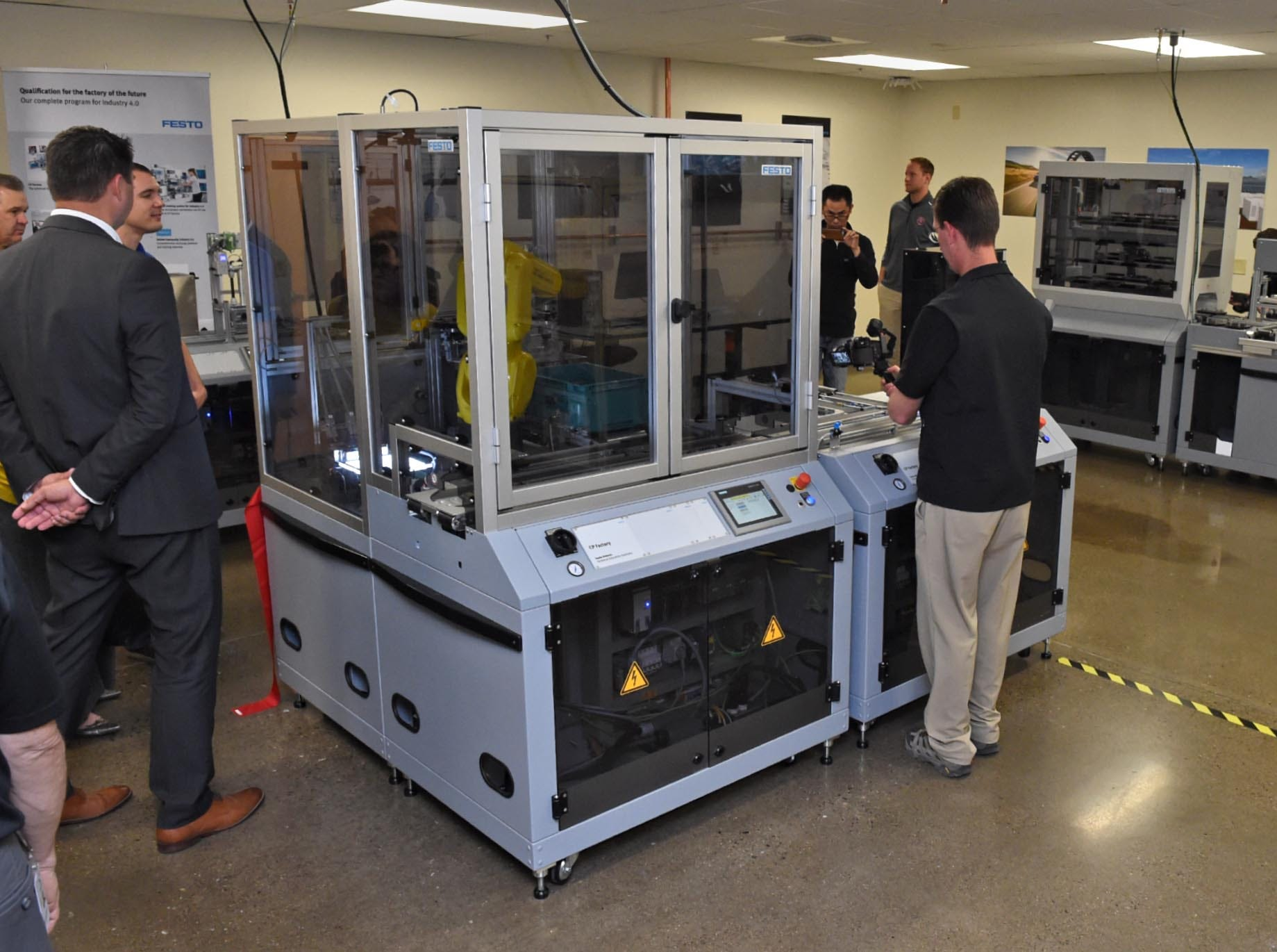 TMCC's Industry 4.0 Advanced Manufacturing Lab. The lab houses a new $755,000 Cyber-Physical Factory. This system will manufacture a mock product in a completely automated environment using scaled down, simulated factory processes such as warehouse, drilling, vision inspection, assembly, thermal station and press.