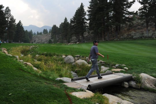 J.J. Henry walks towards the green on the 17th hole during the third round of the Barracuda Championship PGA Tour golf tournament at the Montreux Golf & Country Club in Reno on Aug. 8, 2015.