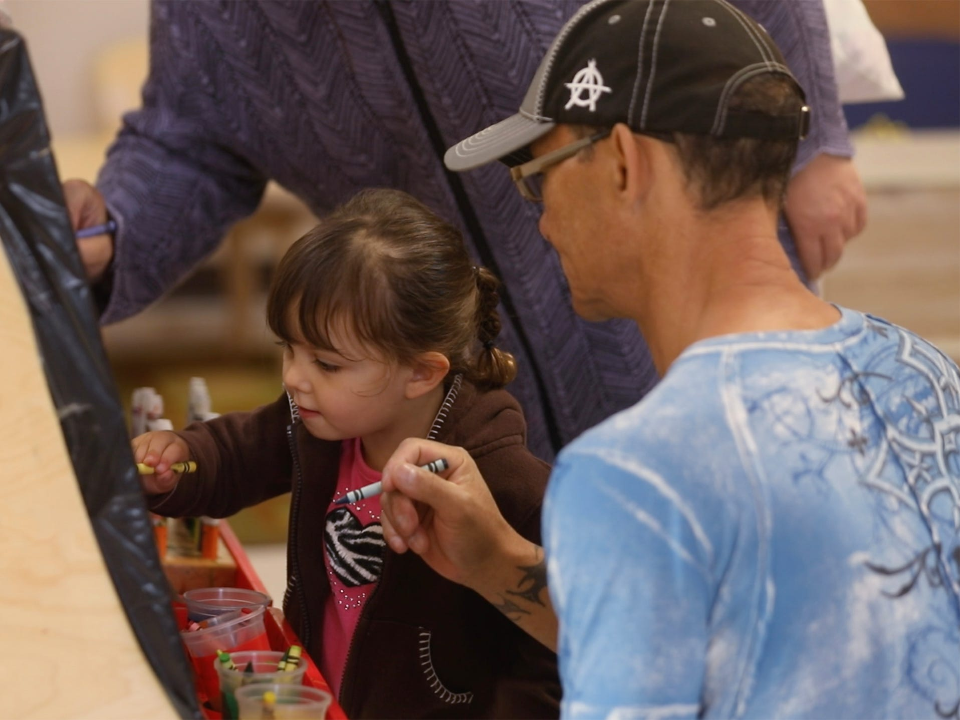 Renay Carter, 2, draws with her parents, Florence and Mark at Glengarry EarlyON Child and Family Centre.  Florence Carter said where she lives there aren't a lot of children her daughter's age and came here.
