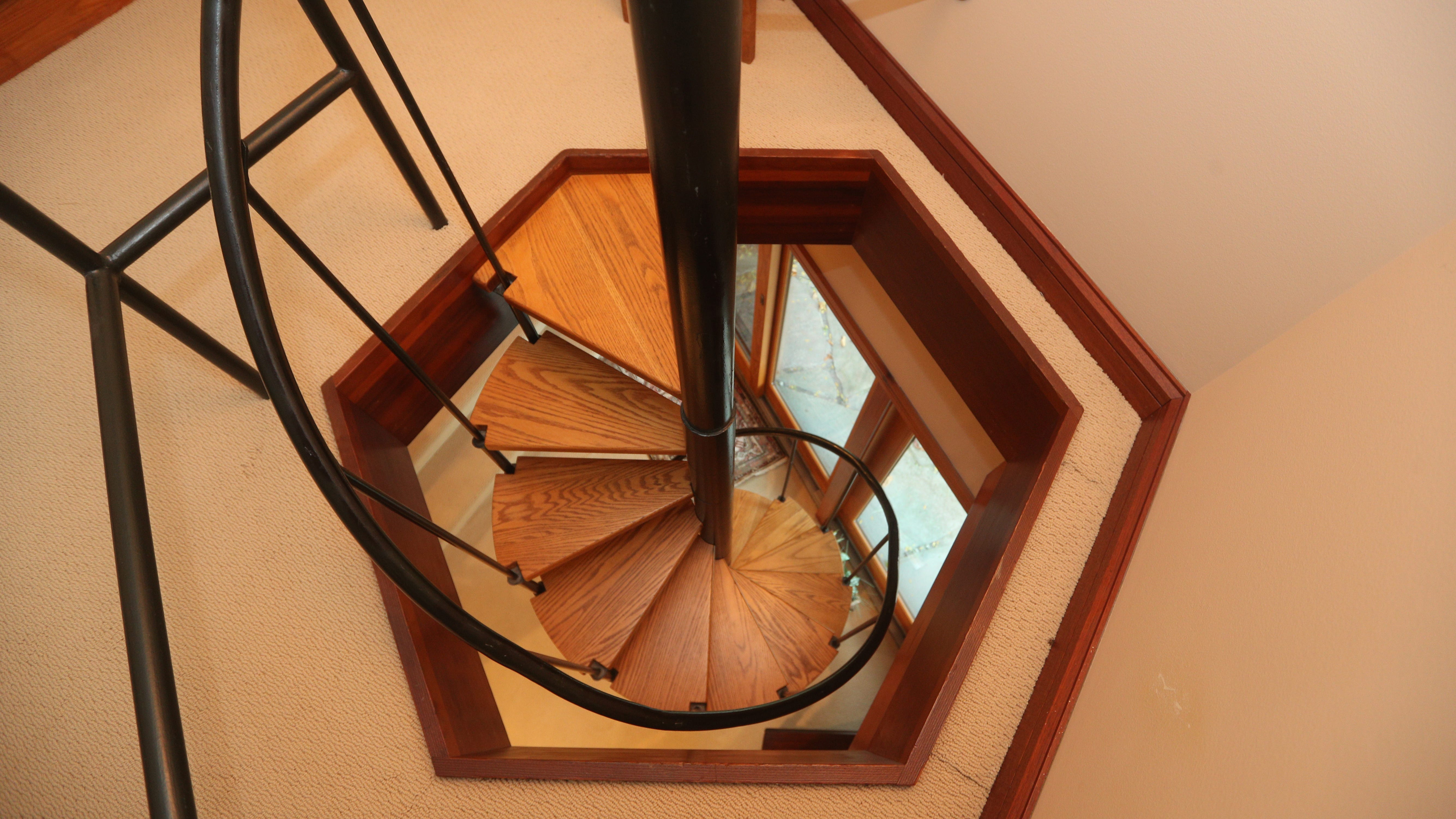 This spiral staircase leads to a cozy loft space.