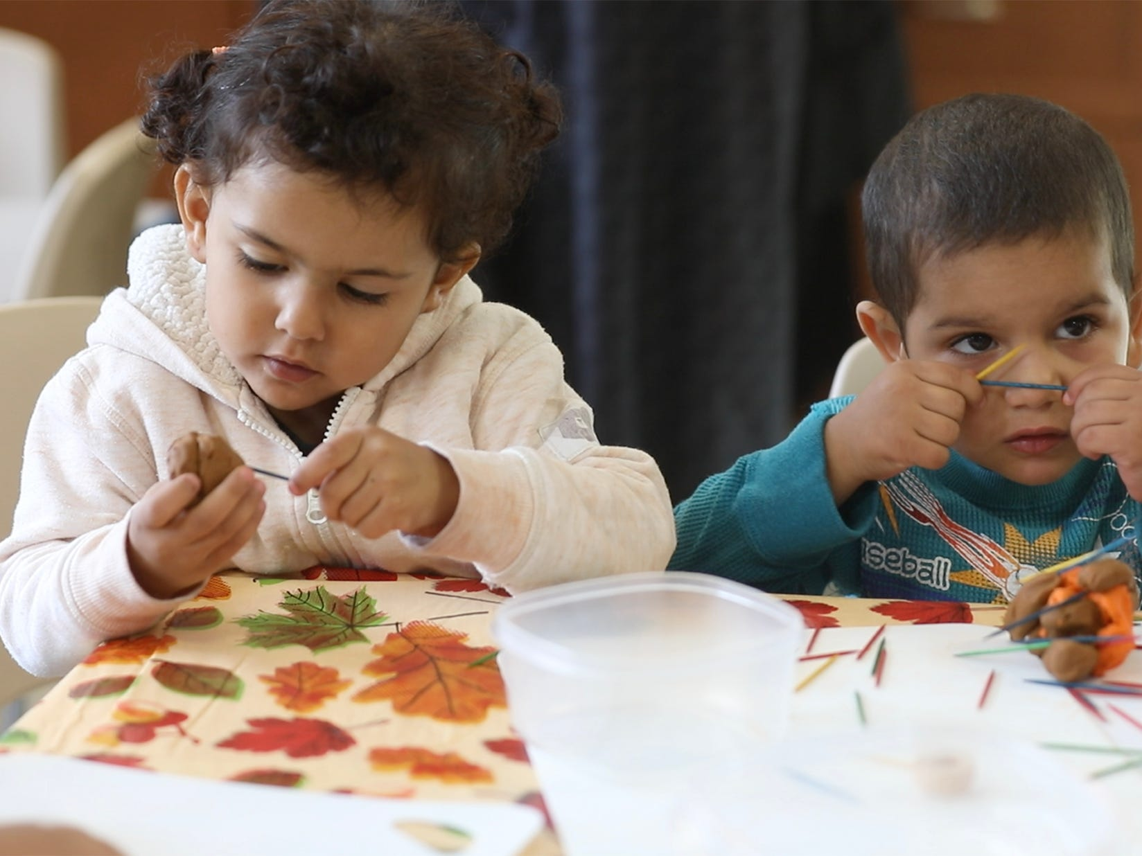 Rahaf Amossa and Souaud Fahed use toothpicks in their dough creation.