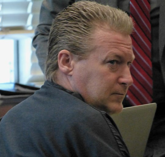 Brian Hawkins sits Wednesday in a Shasta County courtroom at his preliminary hearing.