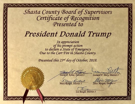 Les Baugh, chairman of the Shasta County Board of Supervisors, presented this certificate to President Trump, thanking him for federal relief help after the Carr Fire.