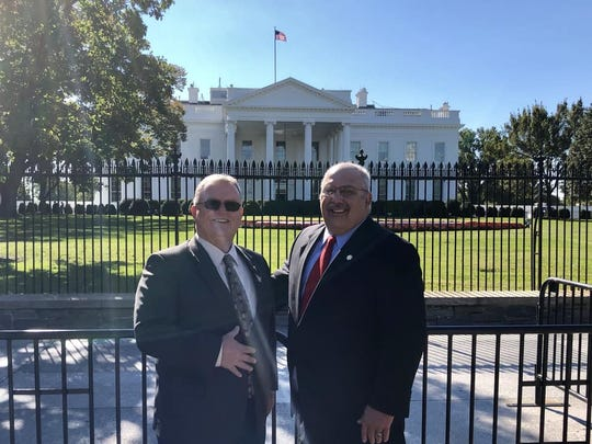 Shasta County Supervisor Les Baugh (left) and Shasta County Sheriff Tom Bosenko stand in front of the White House on Tuesday.