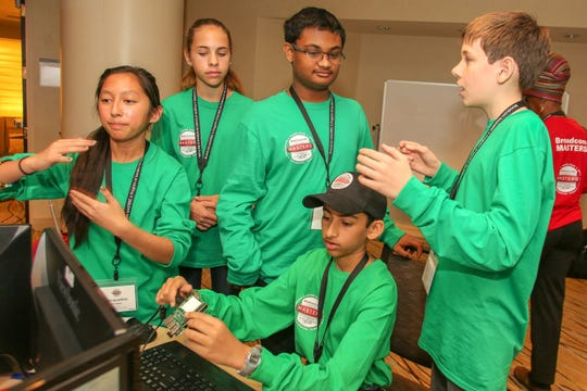 Salem student Mihir Joshi, center, sits at a computer while he competes in a challenge for the national Broadcom Masters STEM finals in Washington, D.C. in Oct. 2018.